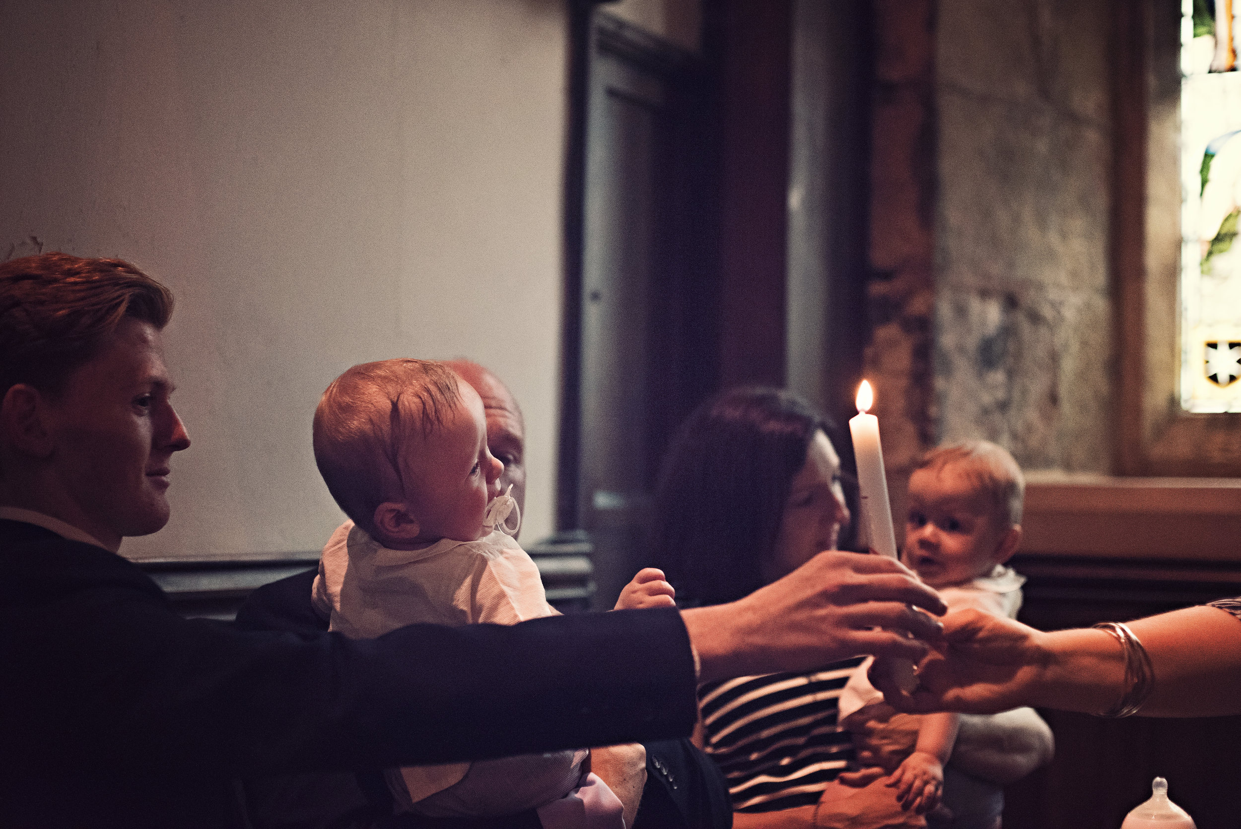 An atmospheric corner with limited natural light offered a challenging shooting condition, but the twins kept themselves entertained by hitting daddy on the head with the hymn sheet throughout!