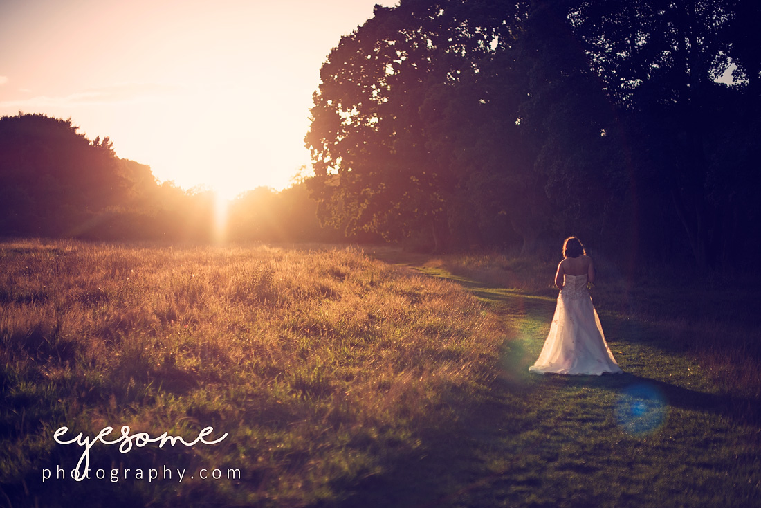 The final shots of the day were at dusk as the sun fell below the horizon. Gnats were buzzing around and the evening light presented us with a beautiful rim light around Issy's gown