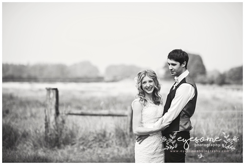 A relaxed and cheerful couple took to the fields on a hazy summer day for portraits