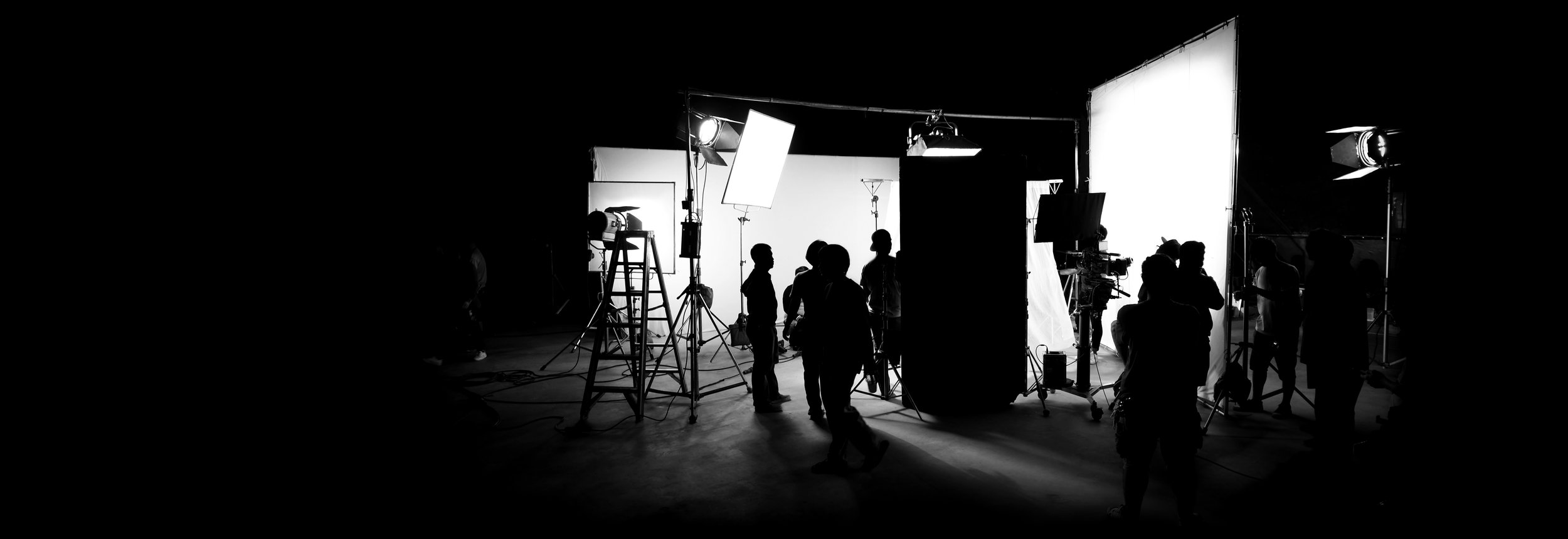 Copy of Silhouette images of video production behind the scenes or b-roll or making of TV commercial movie that film crew team lightman and cameraman working together with director in big studio