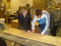 2 Placements from a Social Welfare Provider work together to renovate a wardrobe door.