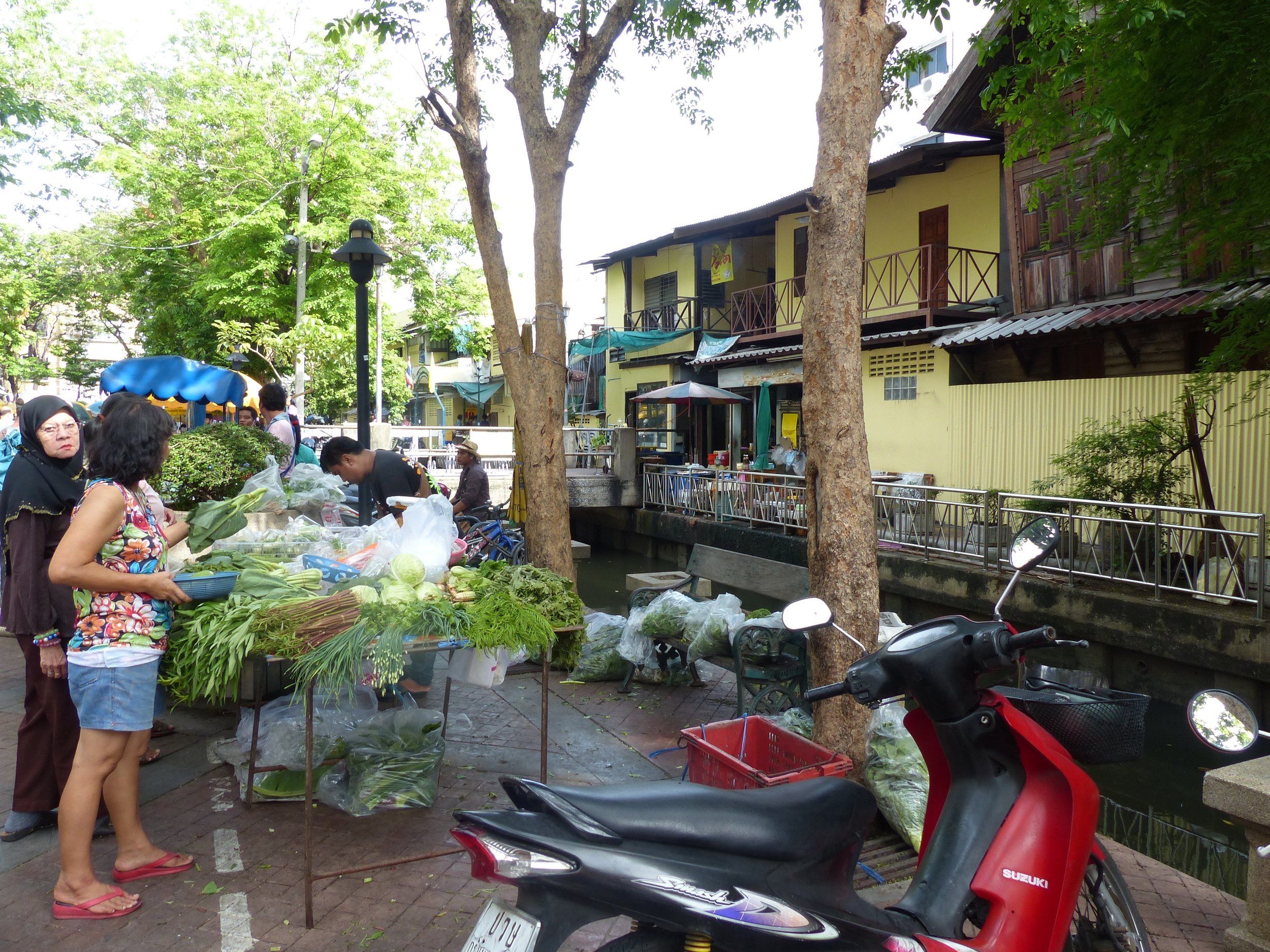 Markets in Bangkok often backed up to canals. Canals where freakishly giant monitor lizards swim, but more on that later.