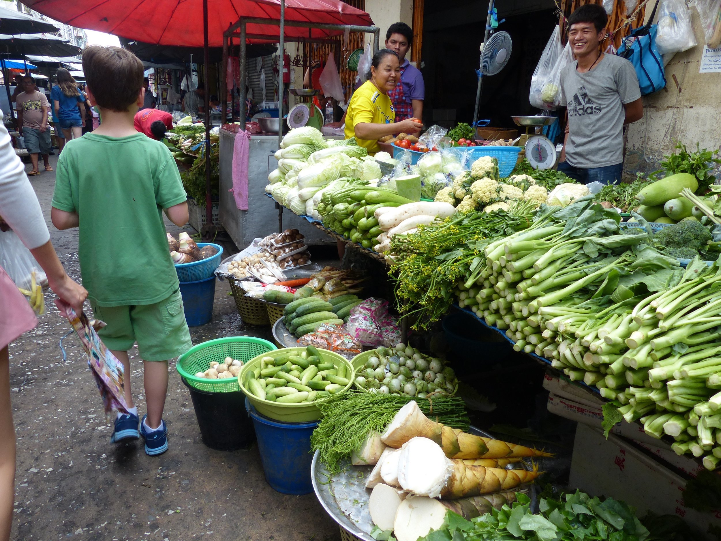 Vendors are more friendly to fruit buyers than distant watchers.
