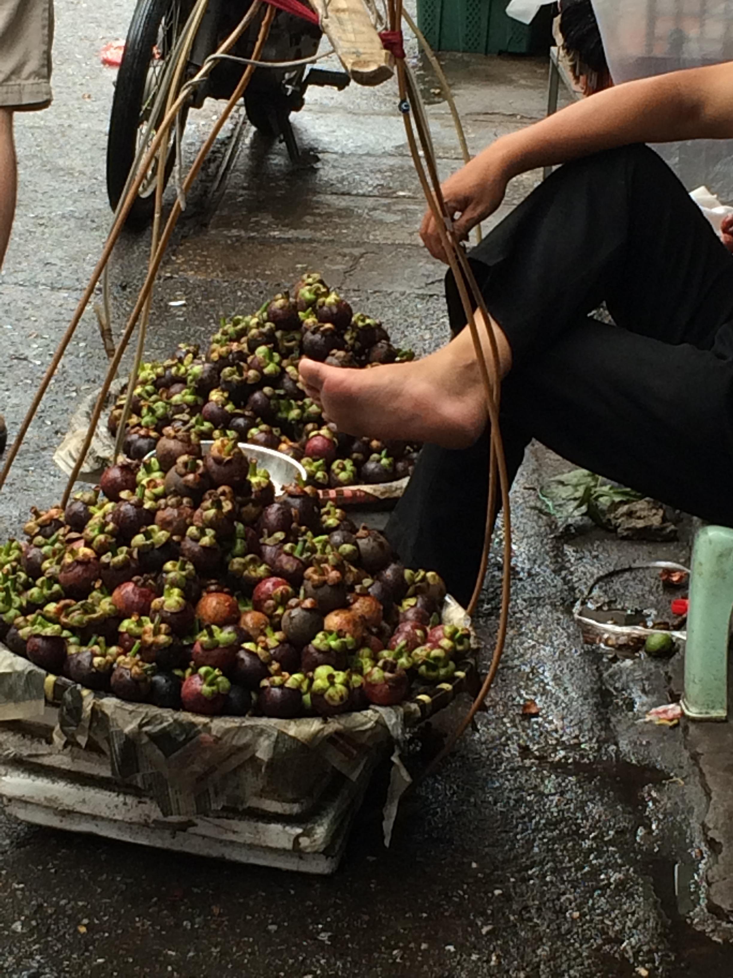 Sidewalk mangosteen seller