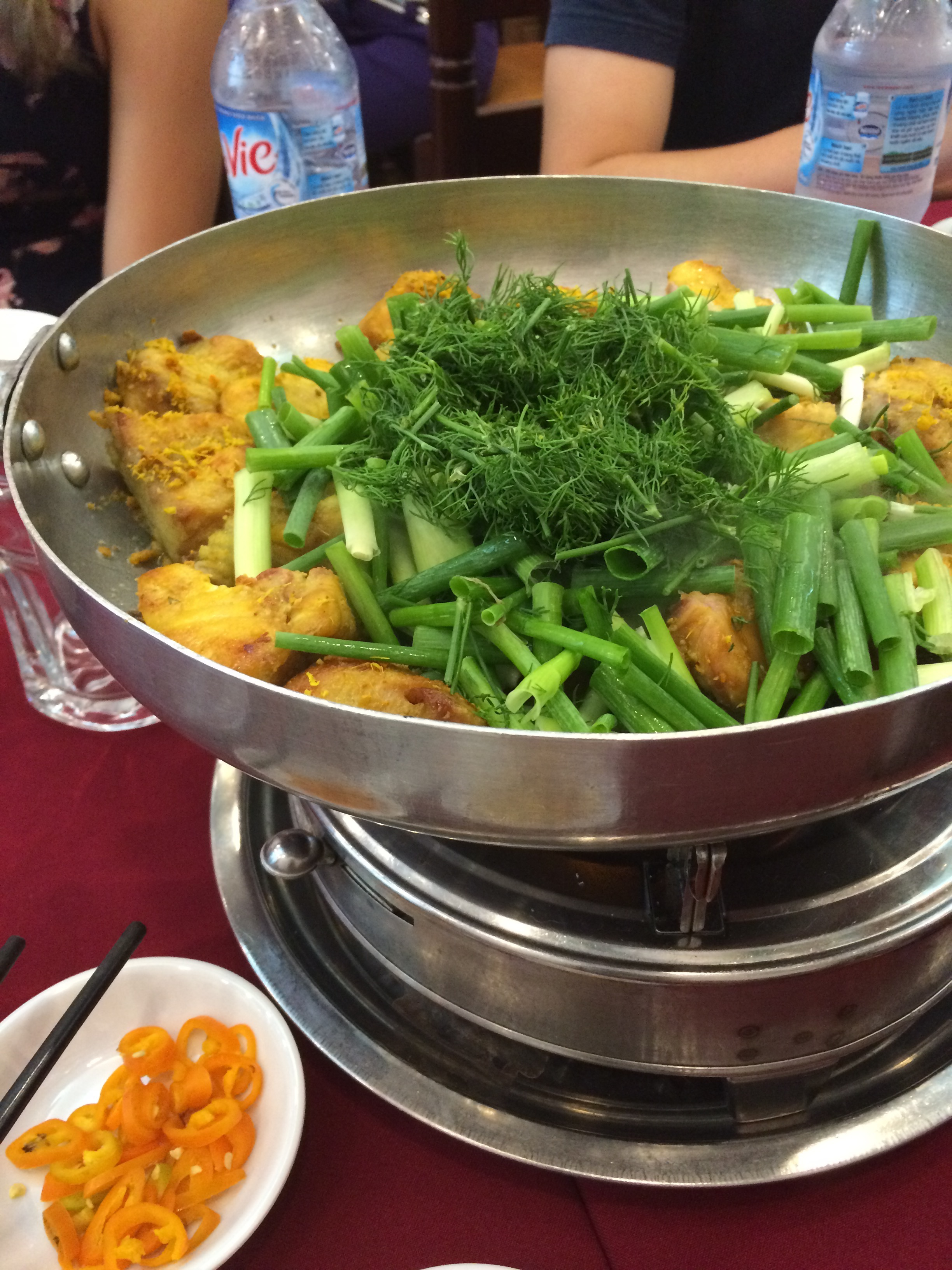 Catfish with tumeric and dill cooked in front of us in Hanoi