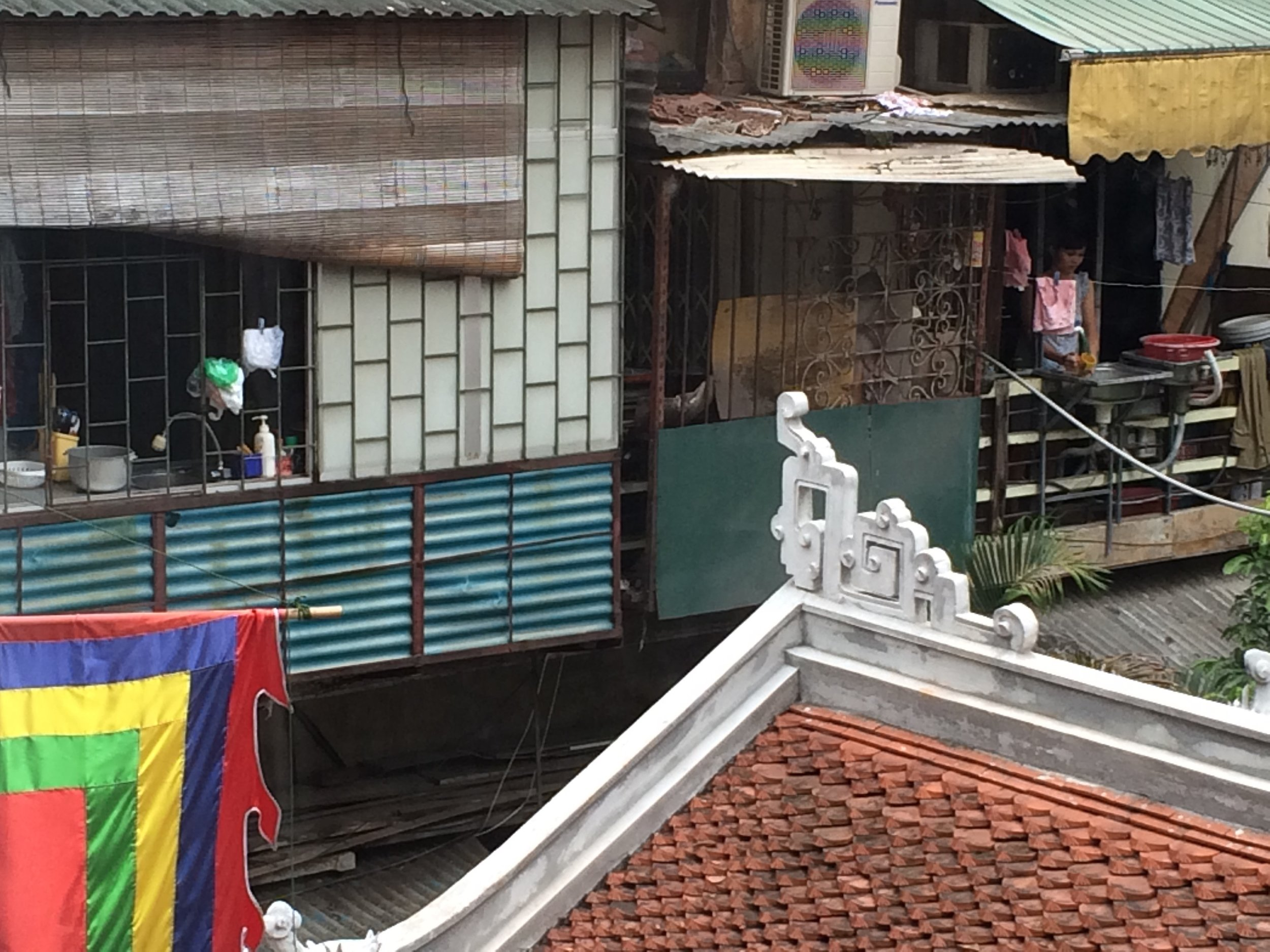 Kitchens hanging on the outside of homes in Hanoi