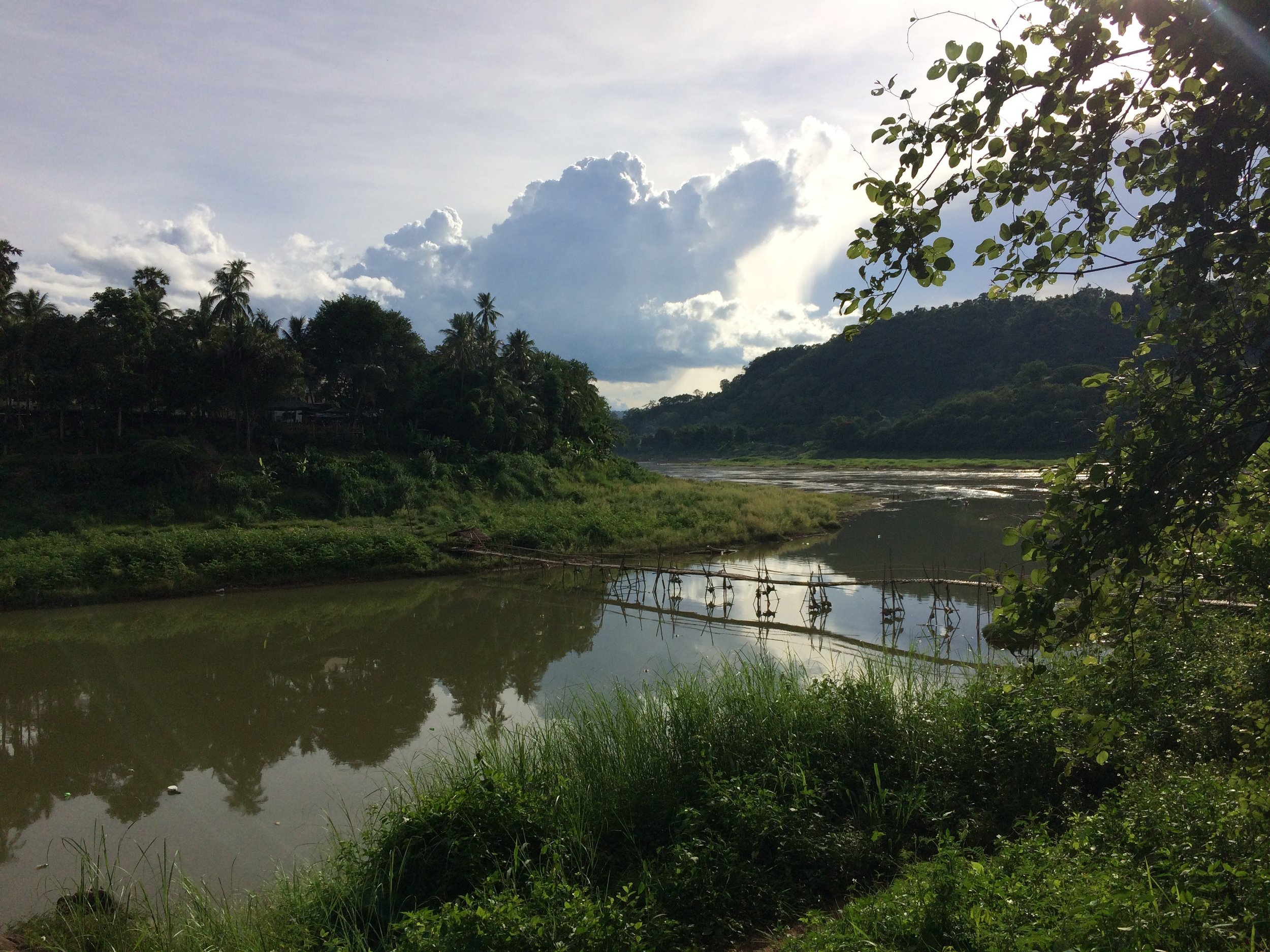 Crossing the bamboo bridge from the handicraft village