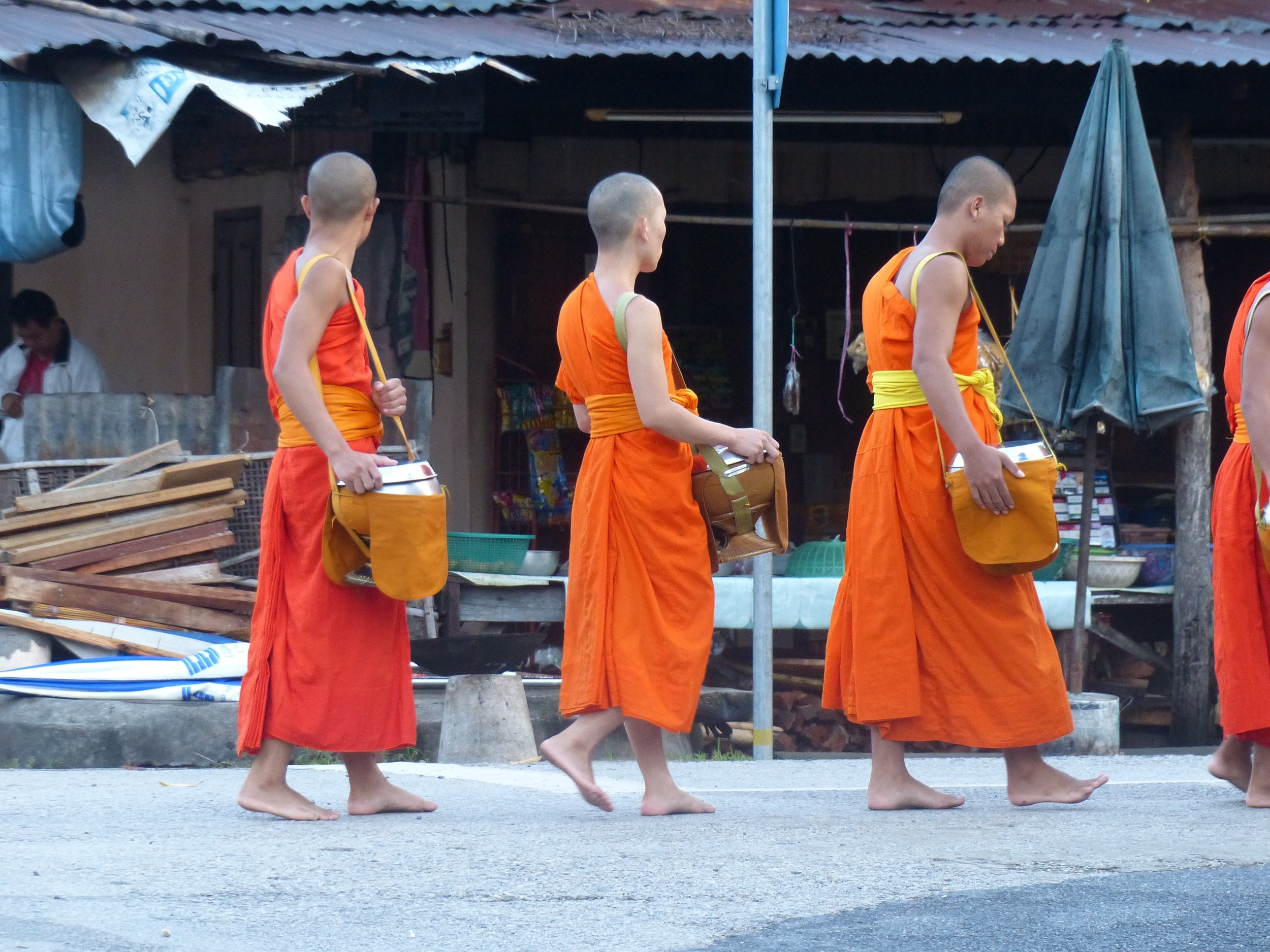 Monks accepting alms.