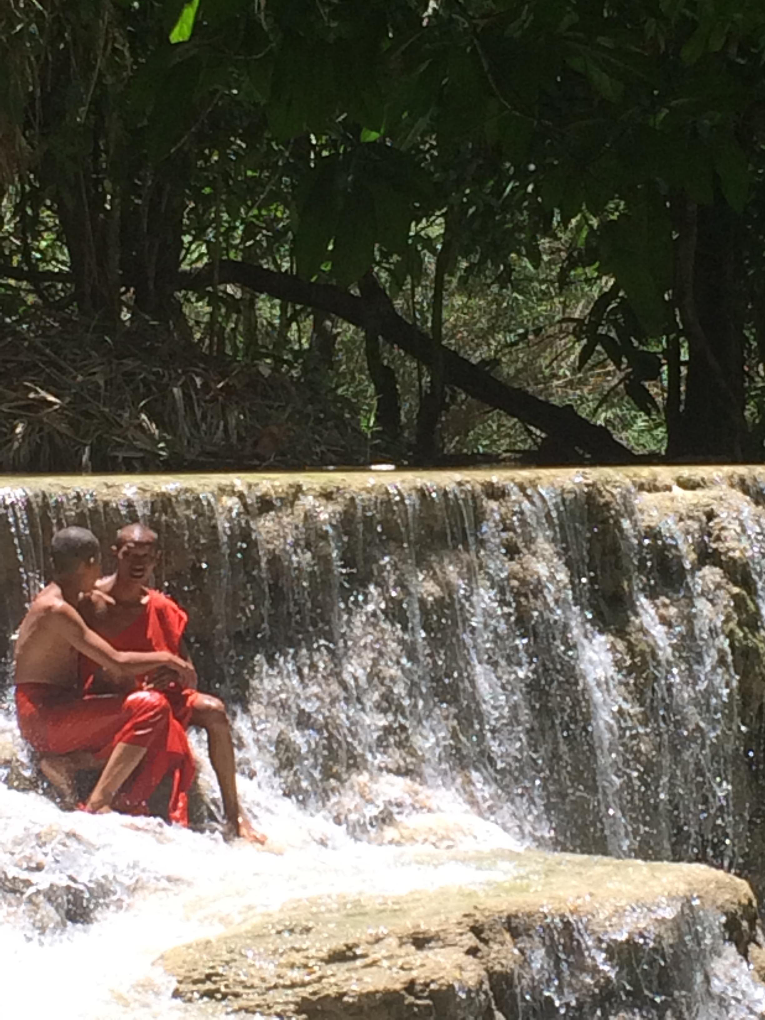 Monks at the Luang Prabang falls.