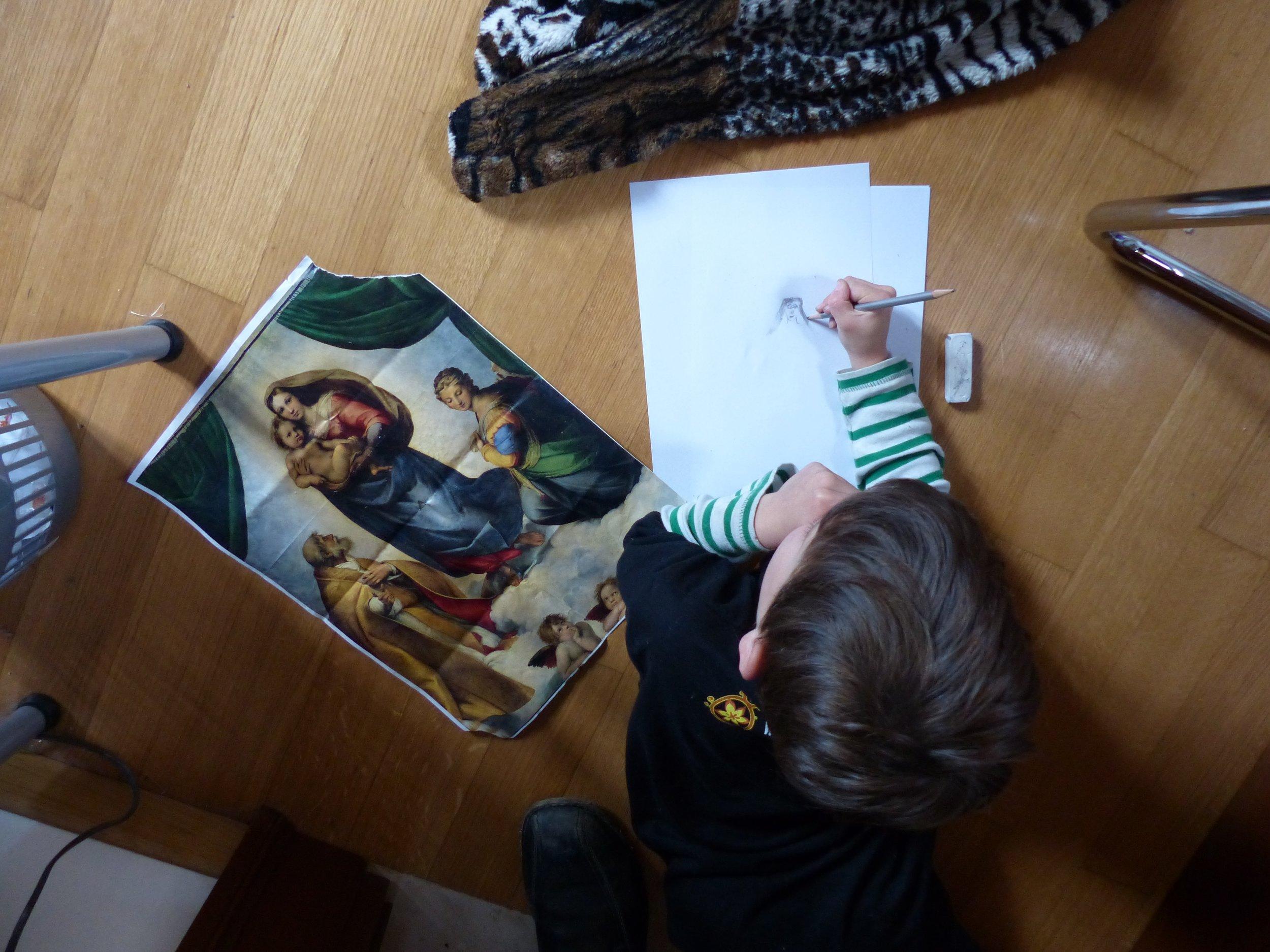 Gabe practices to be a maestro for Flower carpet at Infiorata in Spello, Umbria