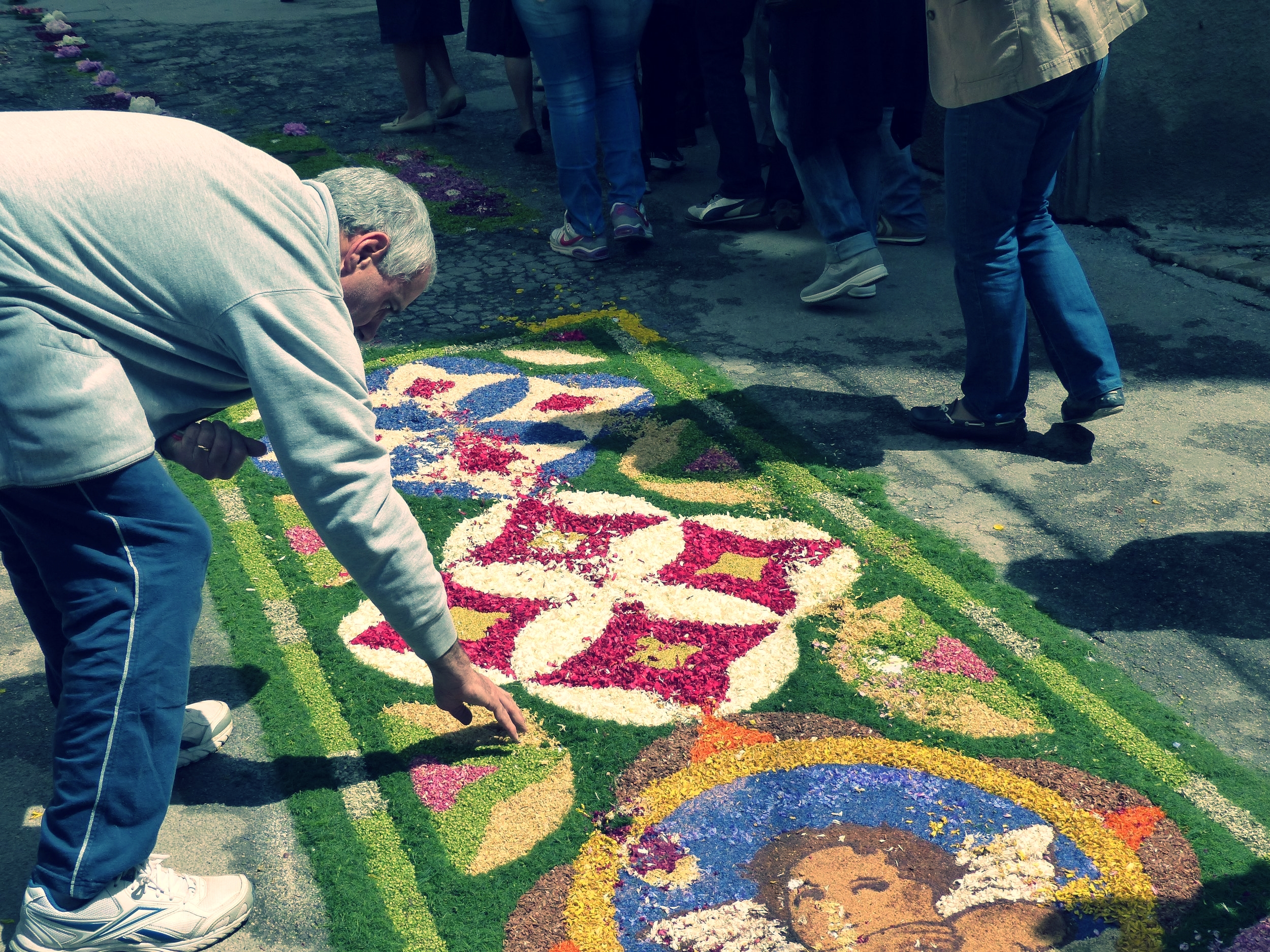 Fixing the flower carpet after Infiorata procession in Spello, Umbria