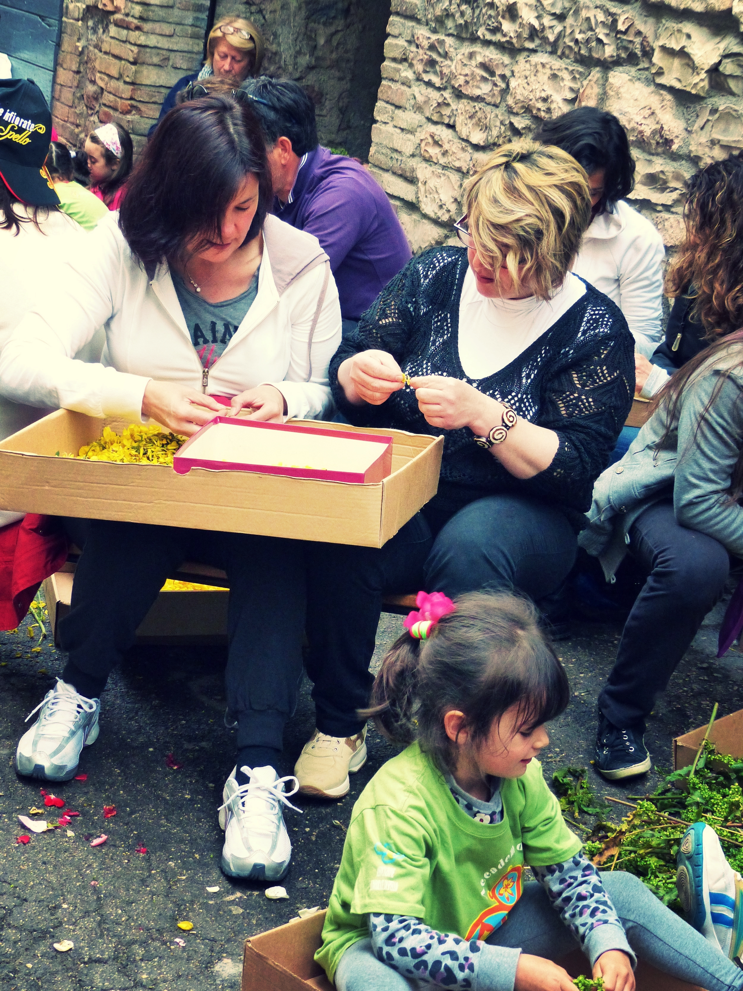 Kids and adults work for Infiorata in Spello, Umbria