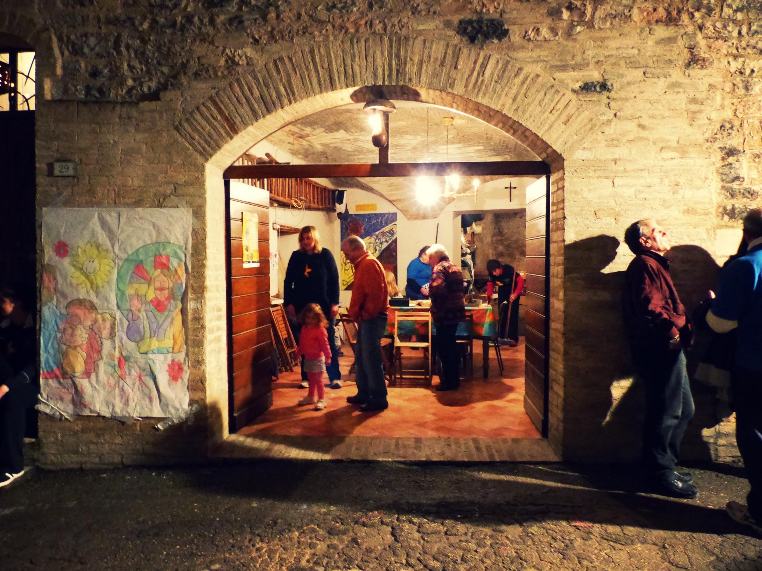 Cantina lit against the night at Infiorata in Spello, Umbria