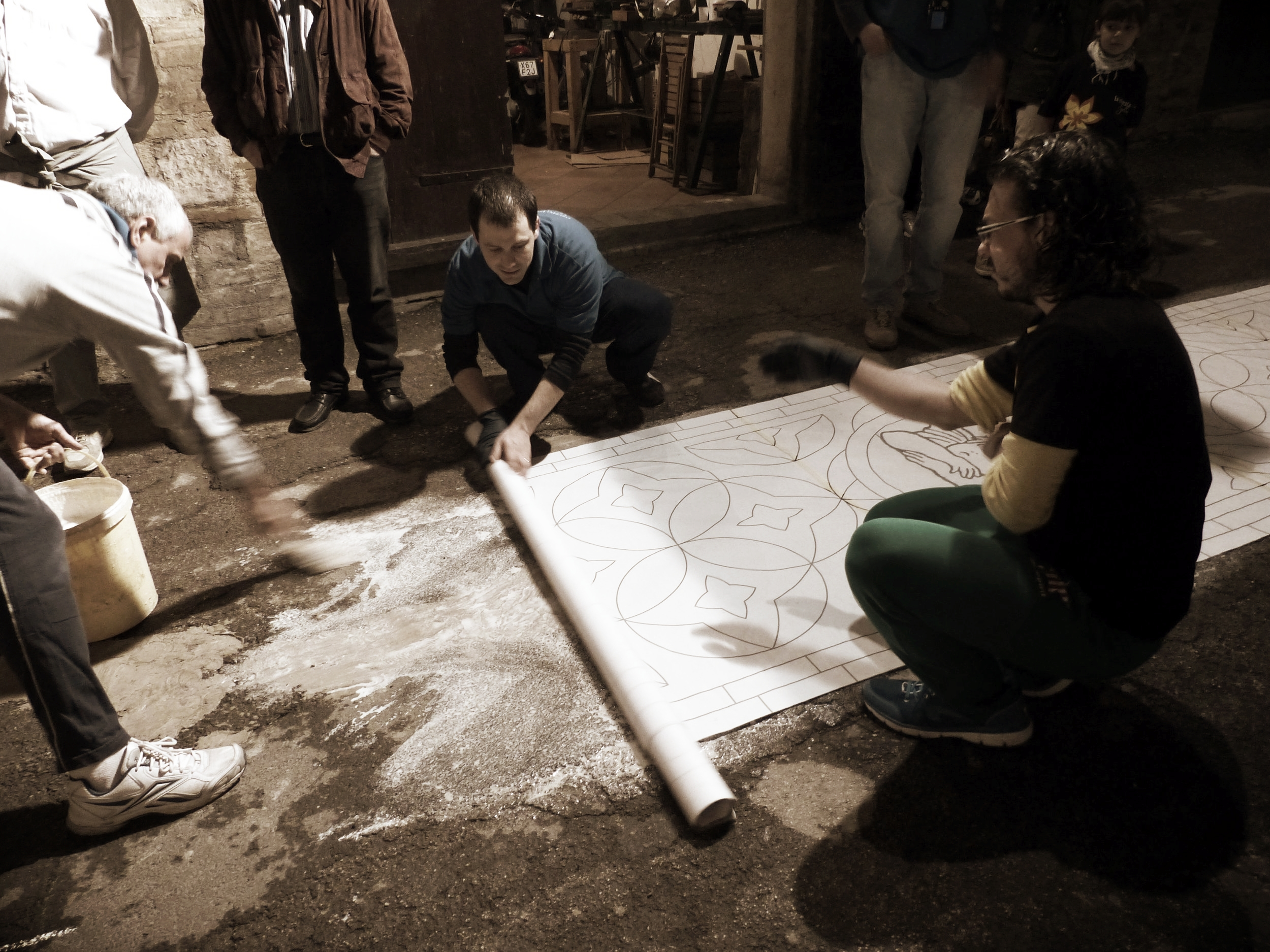 Template adhered to street for Infiorata in Spello, Umbria