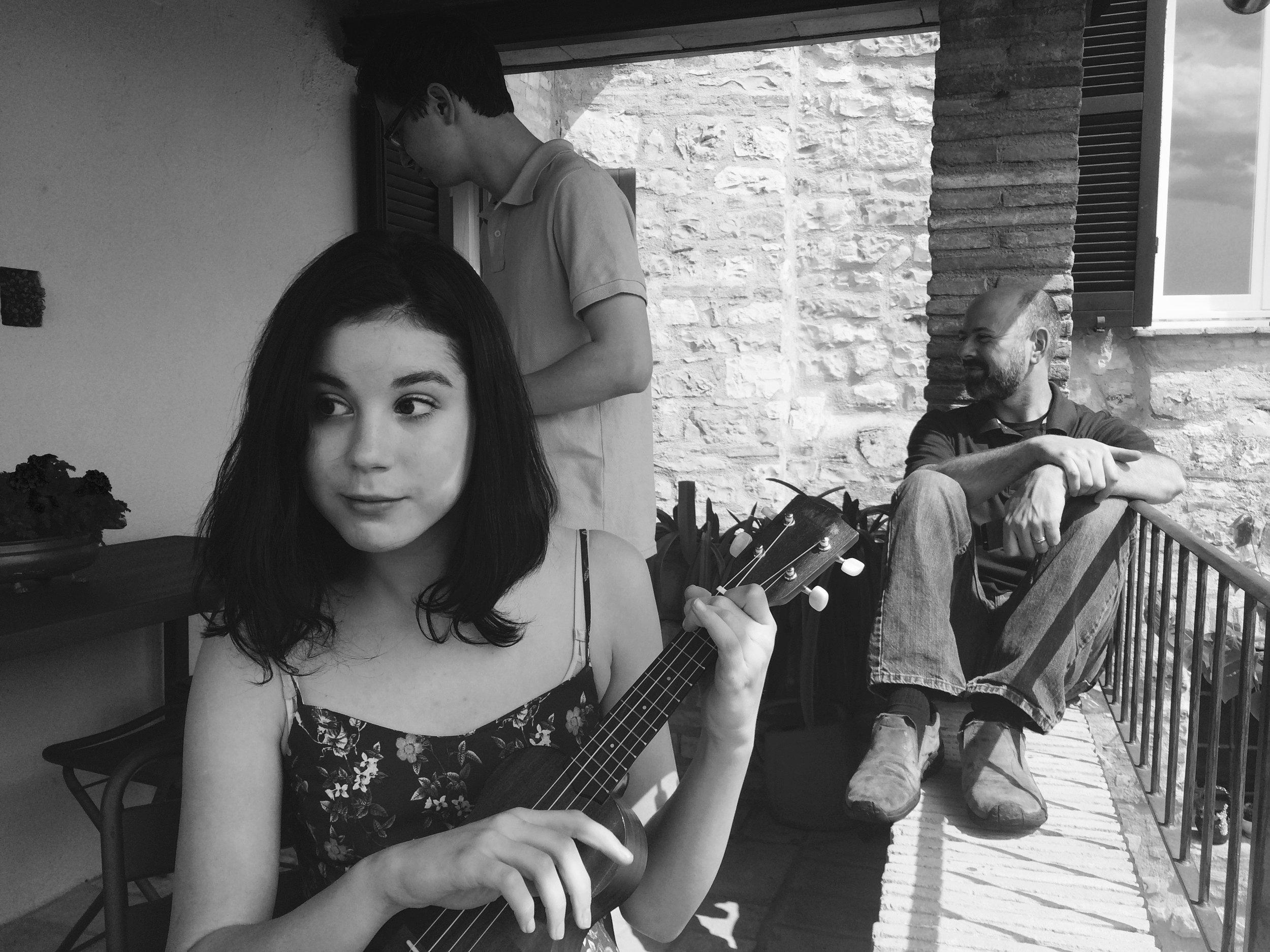 Siena playing uke in Spello, Umbria