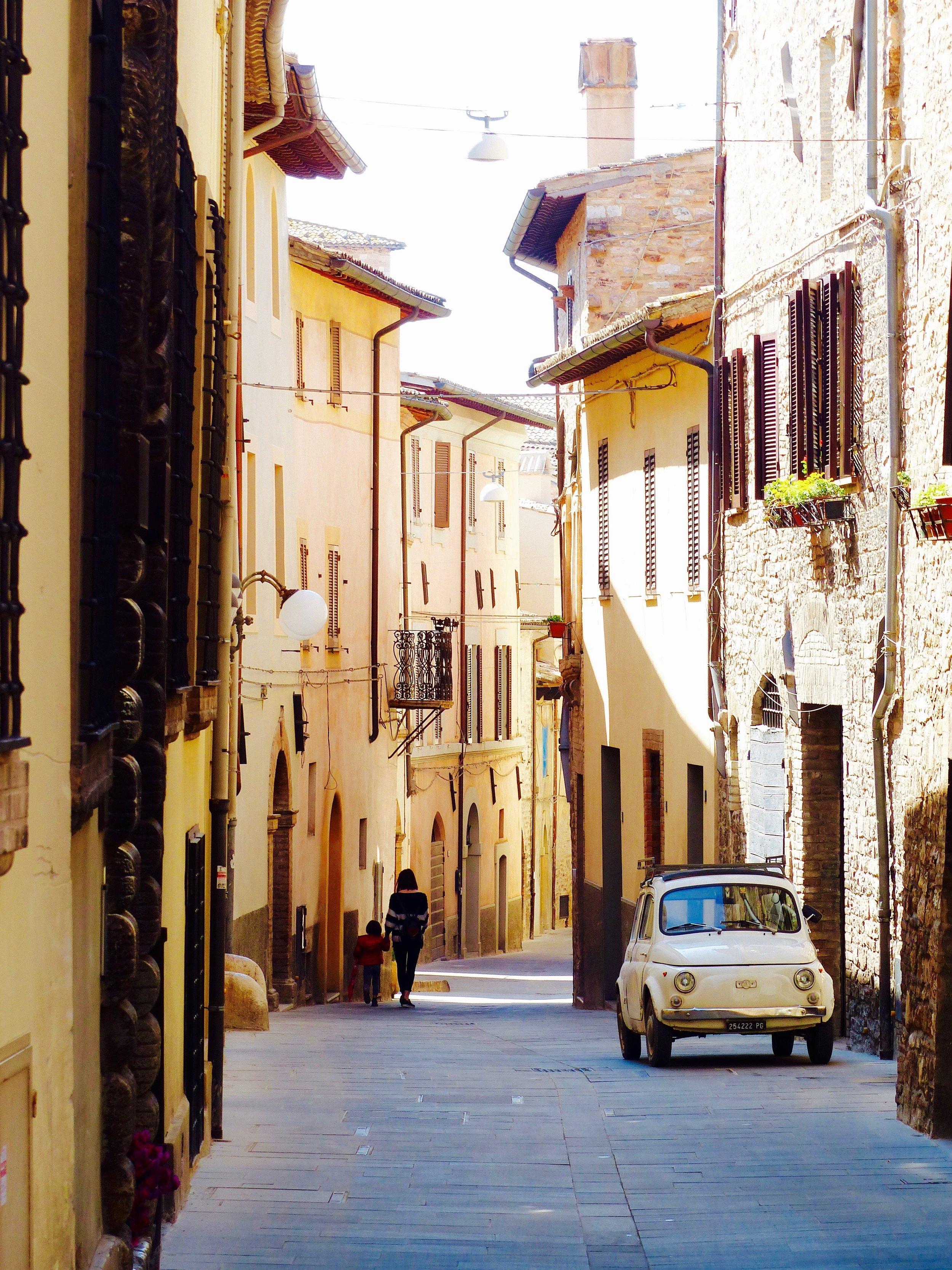 fiat on narrow street in  Spello, Umbria