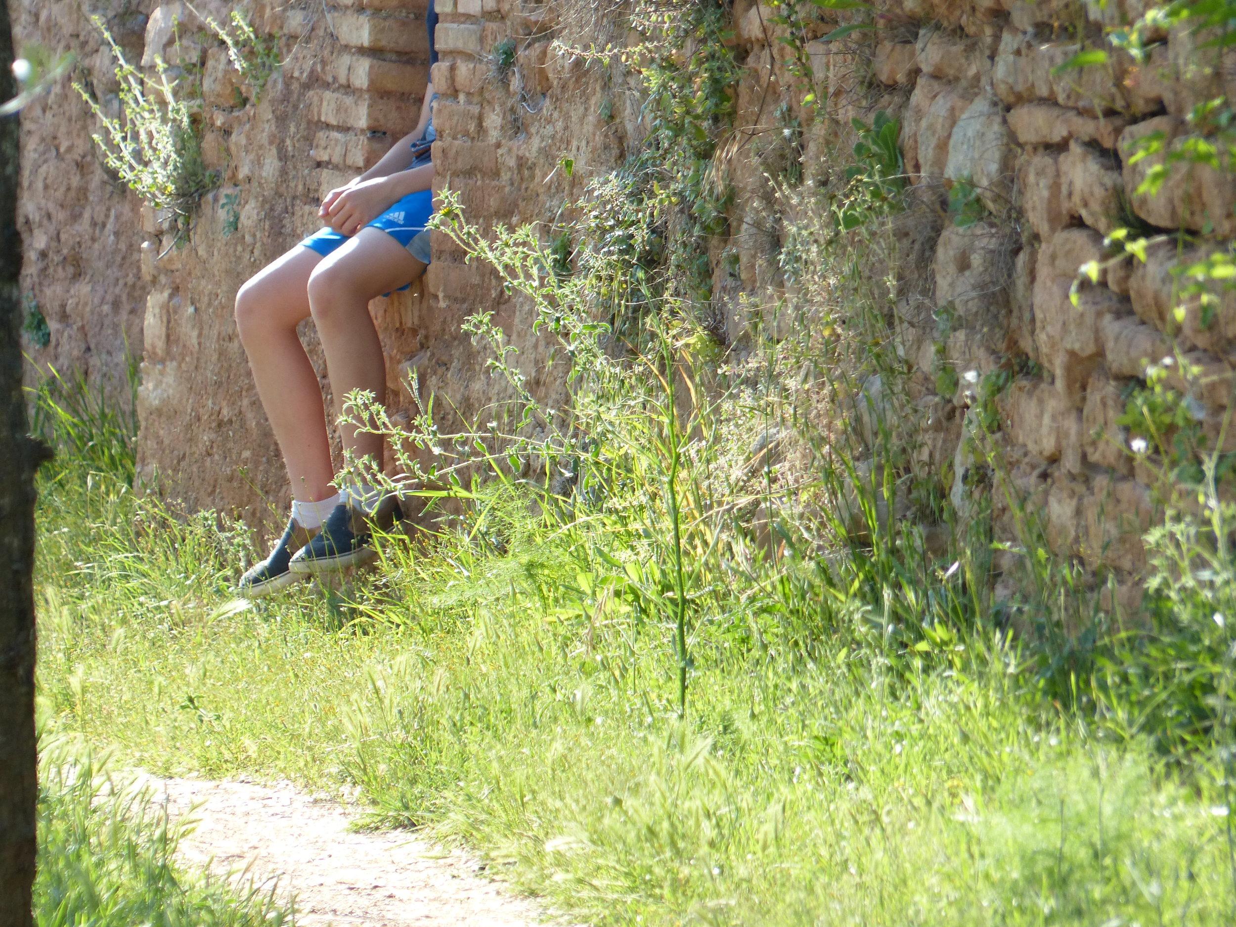 Gabe rests on the aqueduct in Spello, Umbria