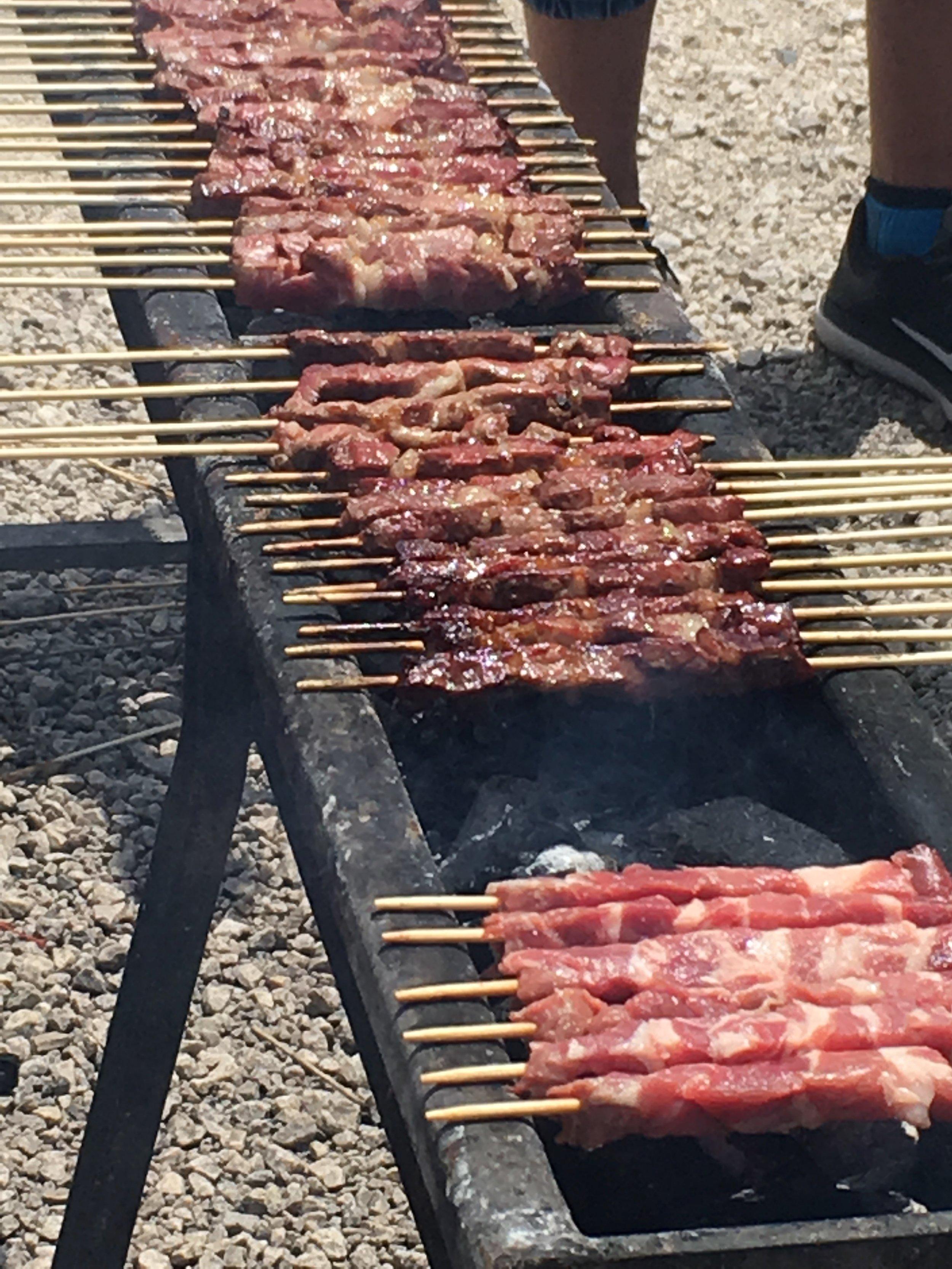 Grilling arrosticini at Ristoro Mucciante in Abruzzo