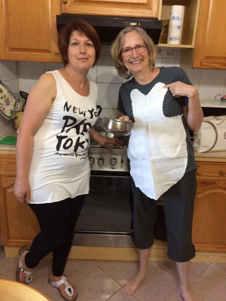 my housekeeper Giovanna with guest Lisa Weitzman showing off Giovanna's handiwork- a mini apron