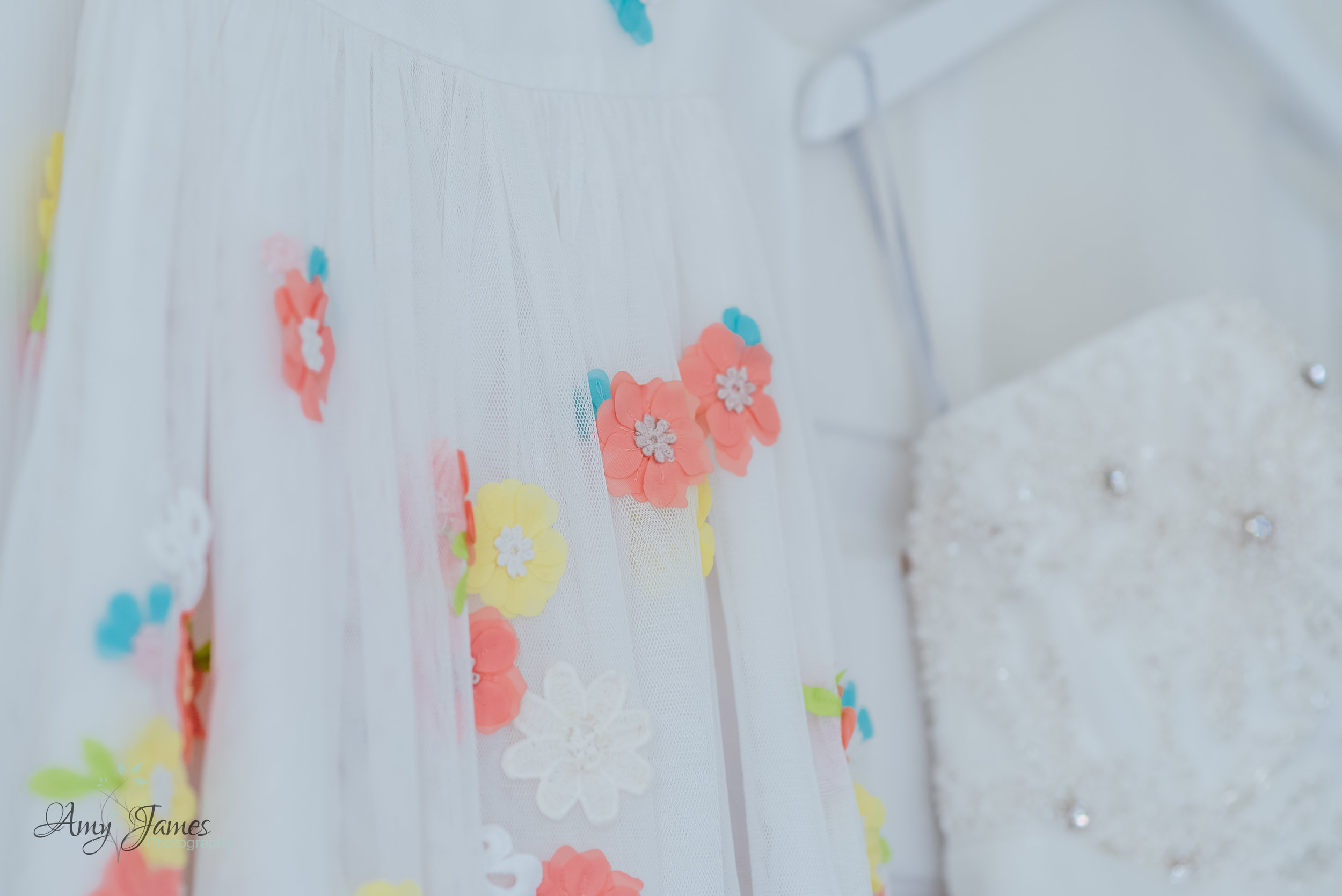 Pretty flower girl dress with orange flowers - Amy James Photography - Hampshire Wedding photographer - Fleet wedding photographer