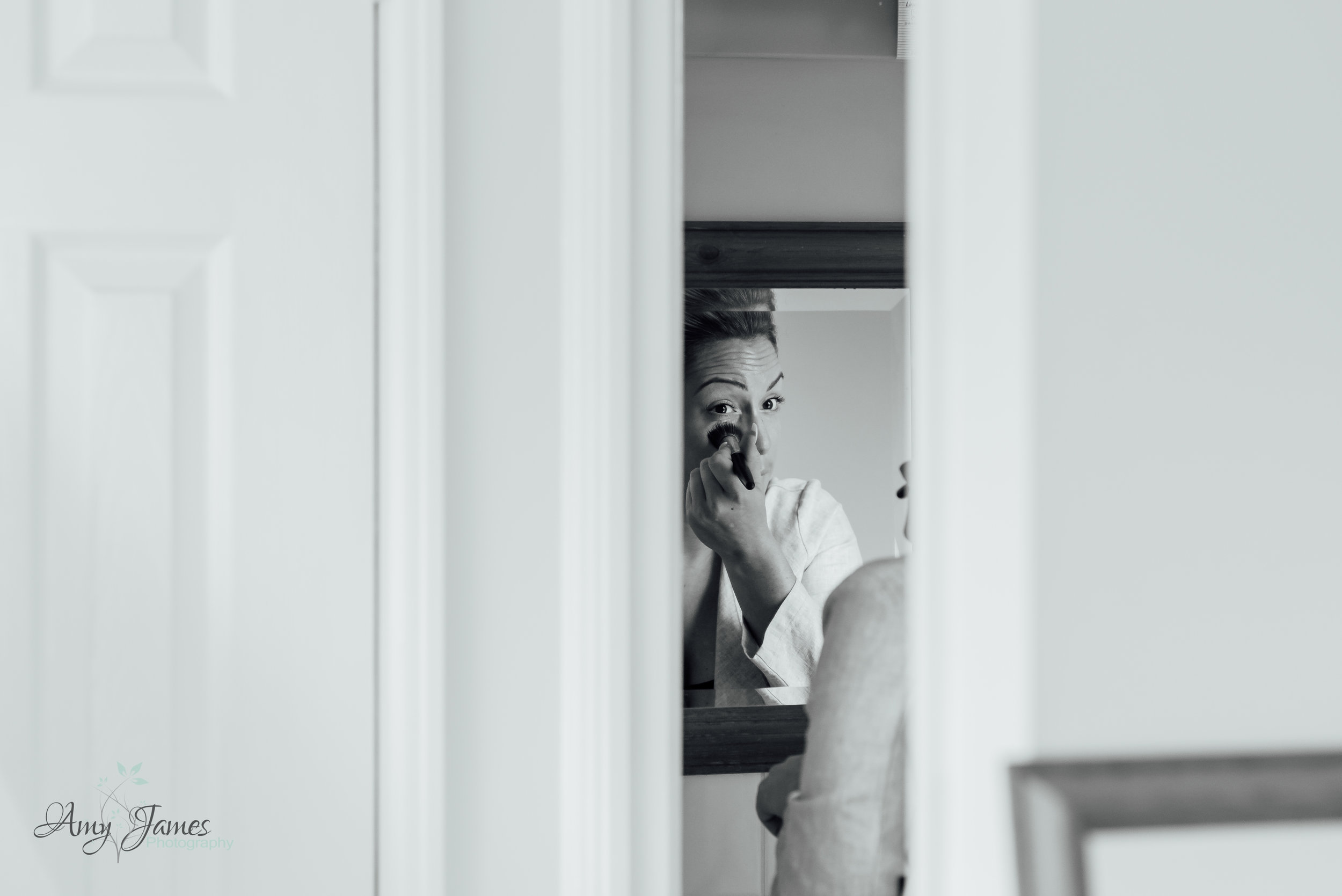 Bride getting ready - Black and white bridal prep photograph - Documentary wedding photography - Amy James Photography - Wedding Photographer Fleet Hampshire
