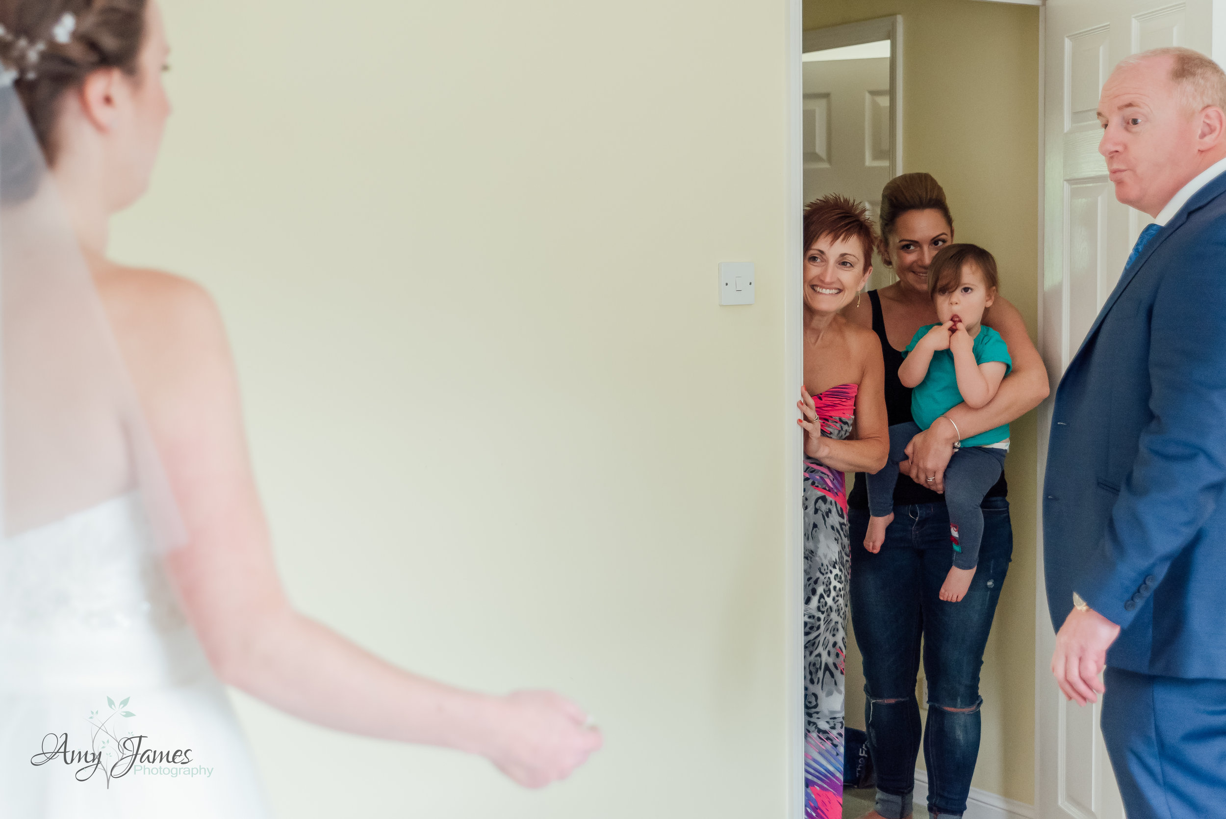 Brides family see her for the first time - First look bridal photograph - Amy James Photography - Taplins Place Wedding Hampshire