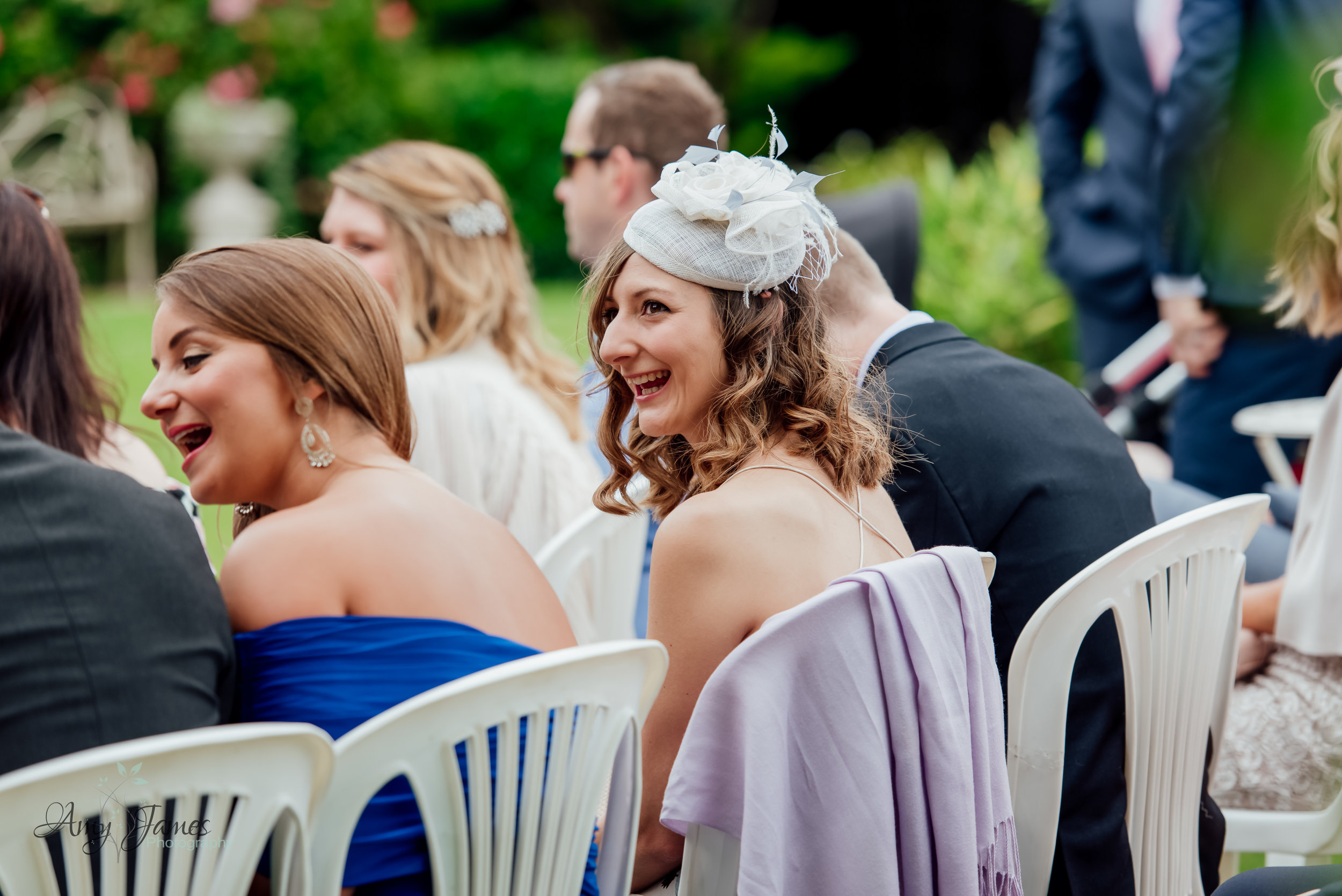 Guests at an outdoor garden wedding ceremony at Taplins Place Hampshire - Amy James photography - Documentary wedding photography