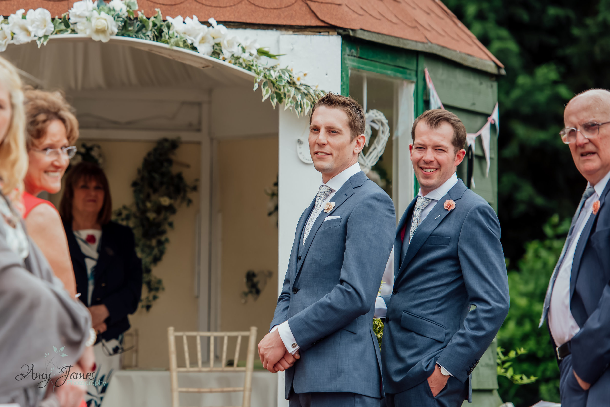 outdoor garden wedding ceremony photograph by Amy James Photography at Taplins Place