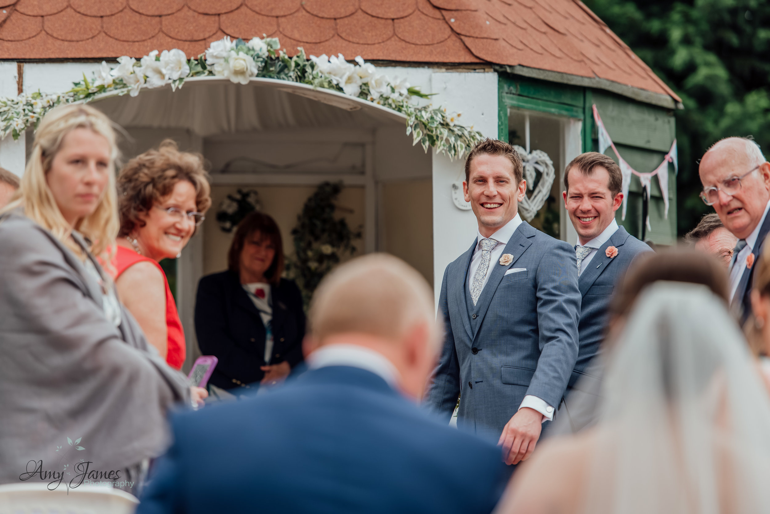 Outdoor wedding ceremony at Taplins Place Hampshire - Groom first look - Amy James photography