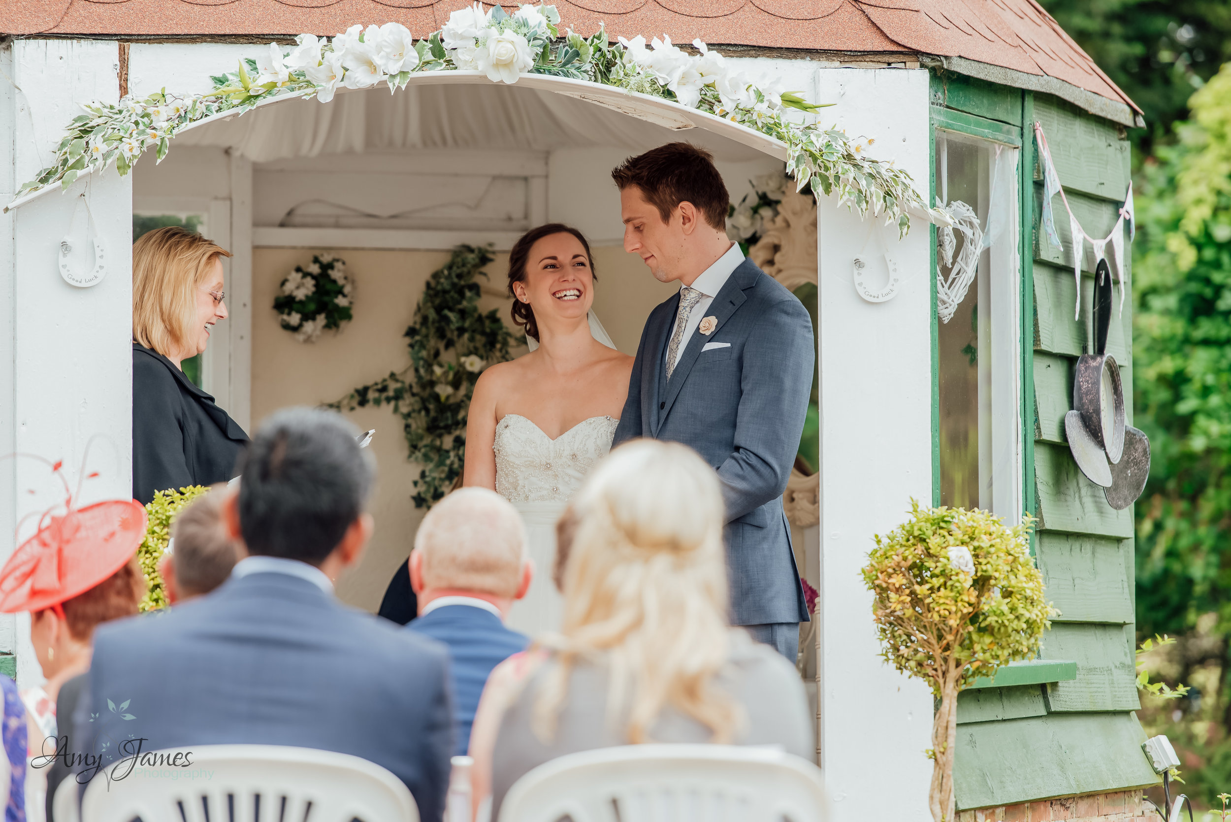 Outdoor garden wedding ceremony photograph at taplins Place Hampshire - Amy James Photography