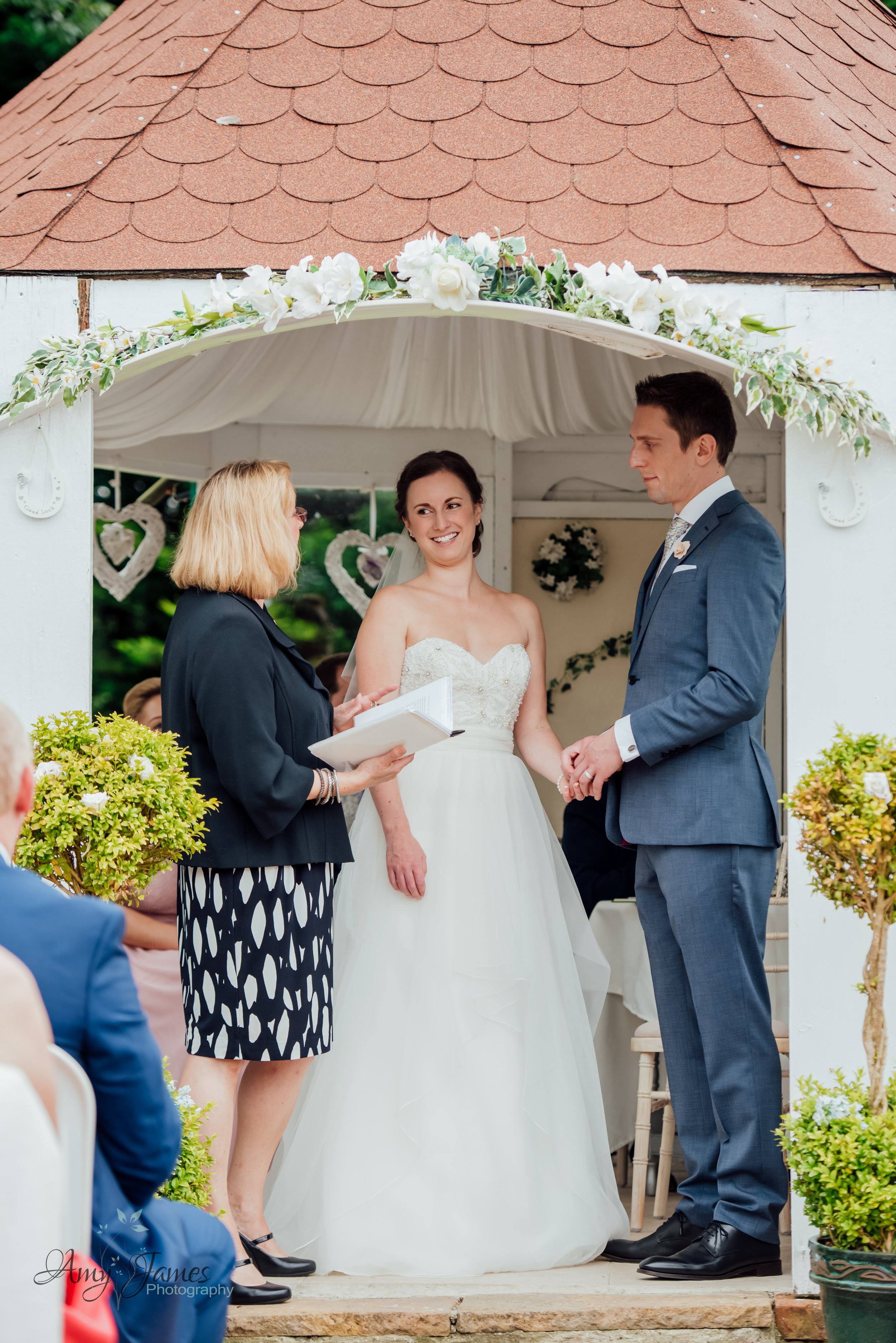 Outdoor garden wedding ceremony photography by Amy James Photography Hampshire Wedding Photographer - Taplins Place Wedding