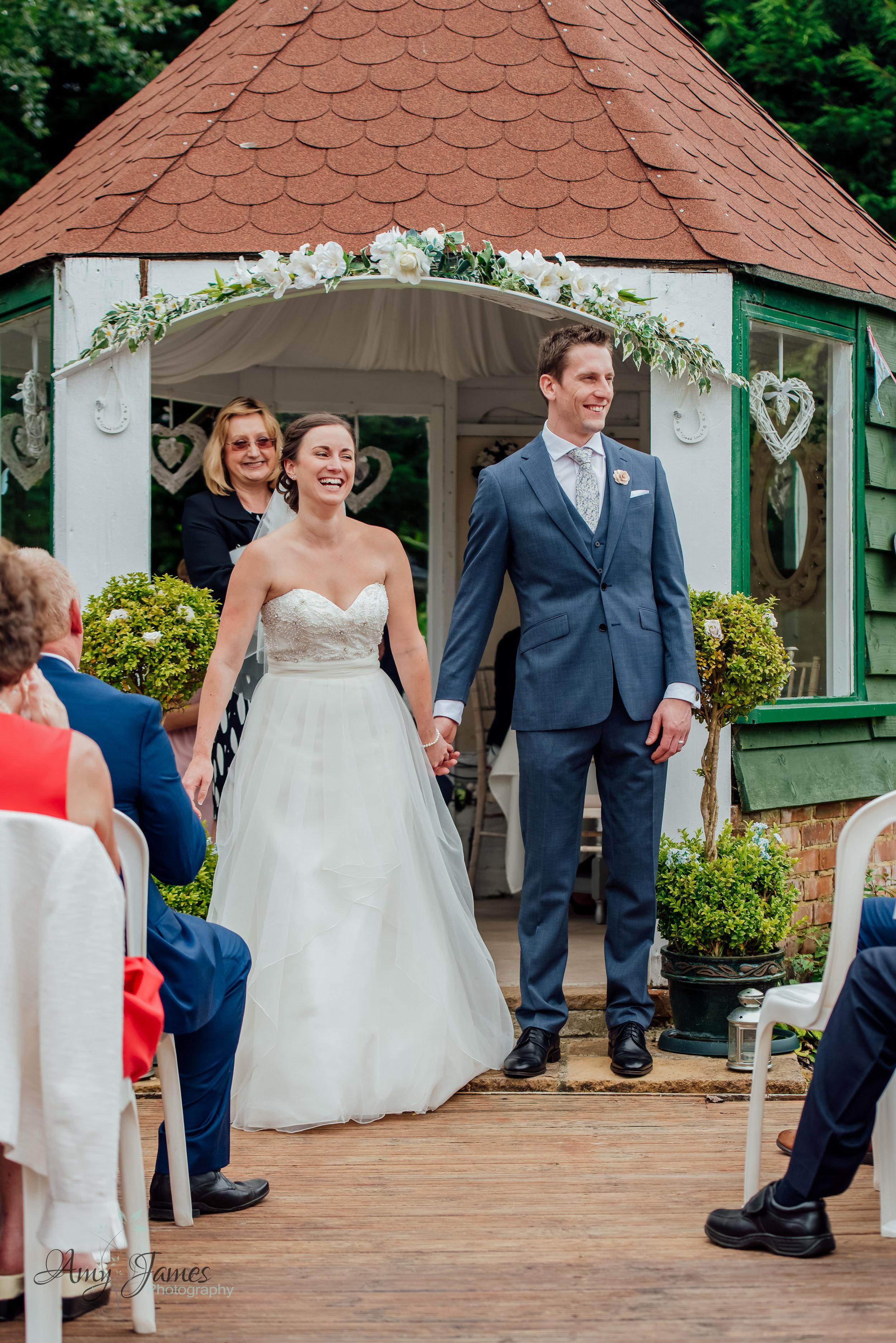 Outdoor garden wedding ceremony photograph by Amy James Photography Hampshire Wedding Photographer - Taplins Place Wedding