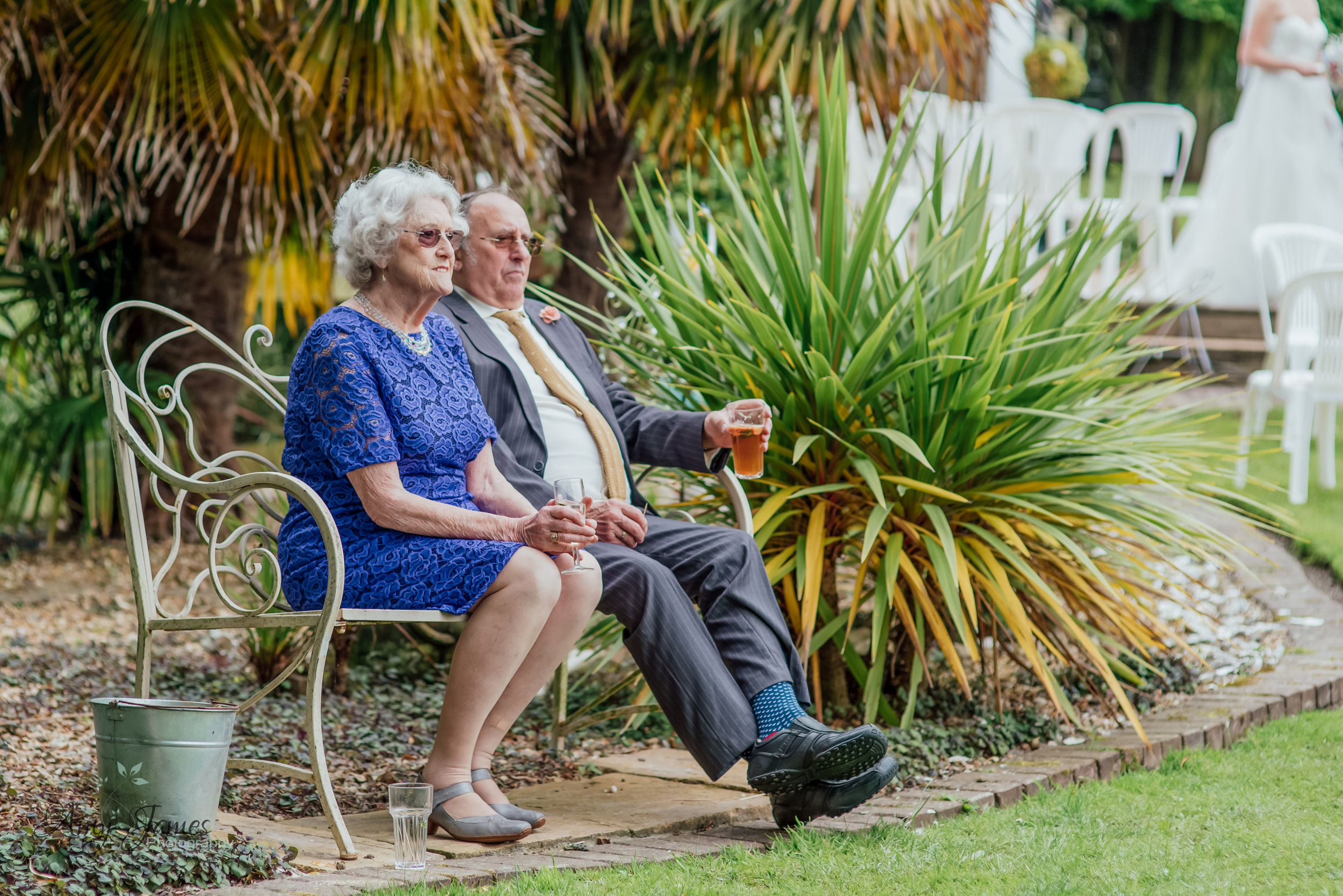 Elderly guests at outdoor wedding ceremony by Amy James Photography at Taplins Place Hampshire wedding photographer