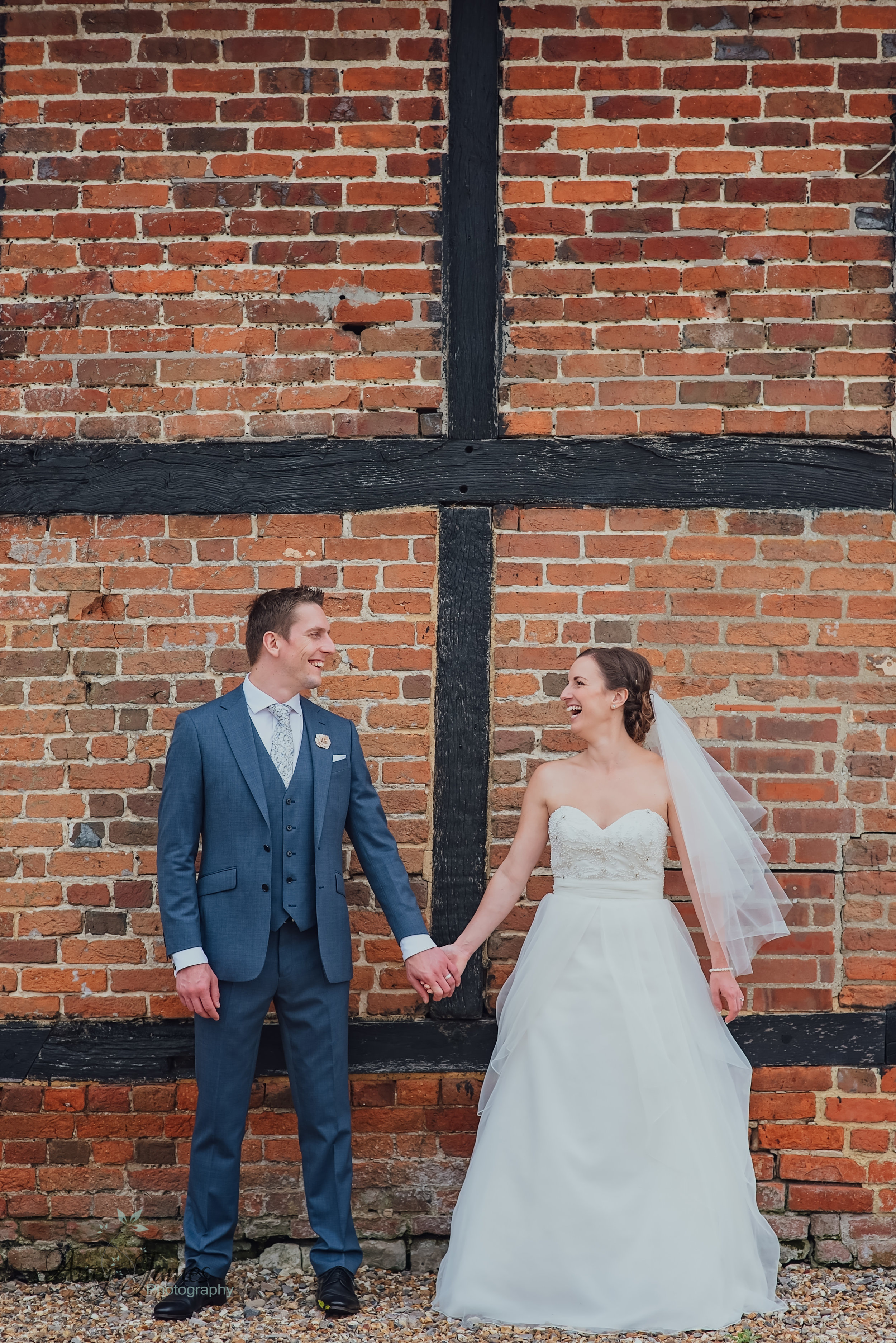 Bride and Groom at outside wedding venue Taplins Place Hampshire by Amy James Photography Hampshire wedding photographer
