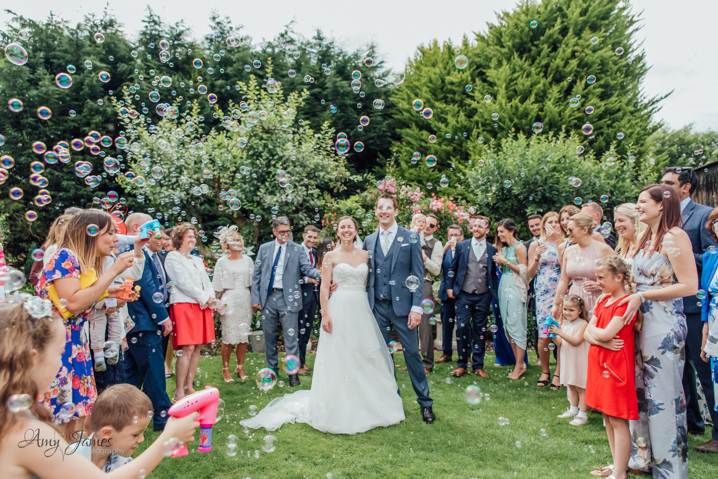 Bubble gun wedding confetti at outdoor wedding venue Hampshire - Amy James Photography Hampshire Fleet wedding photographer