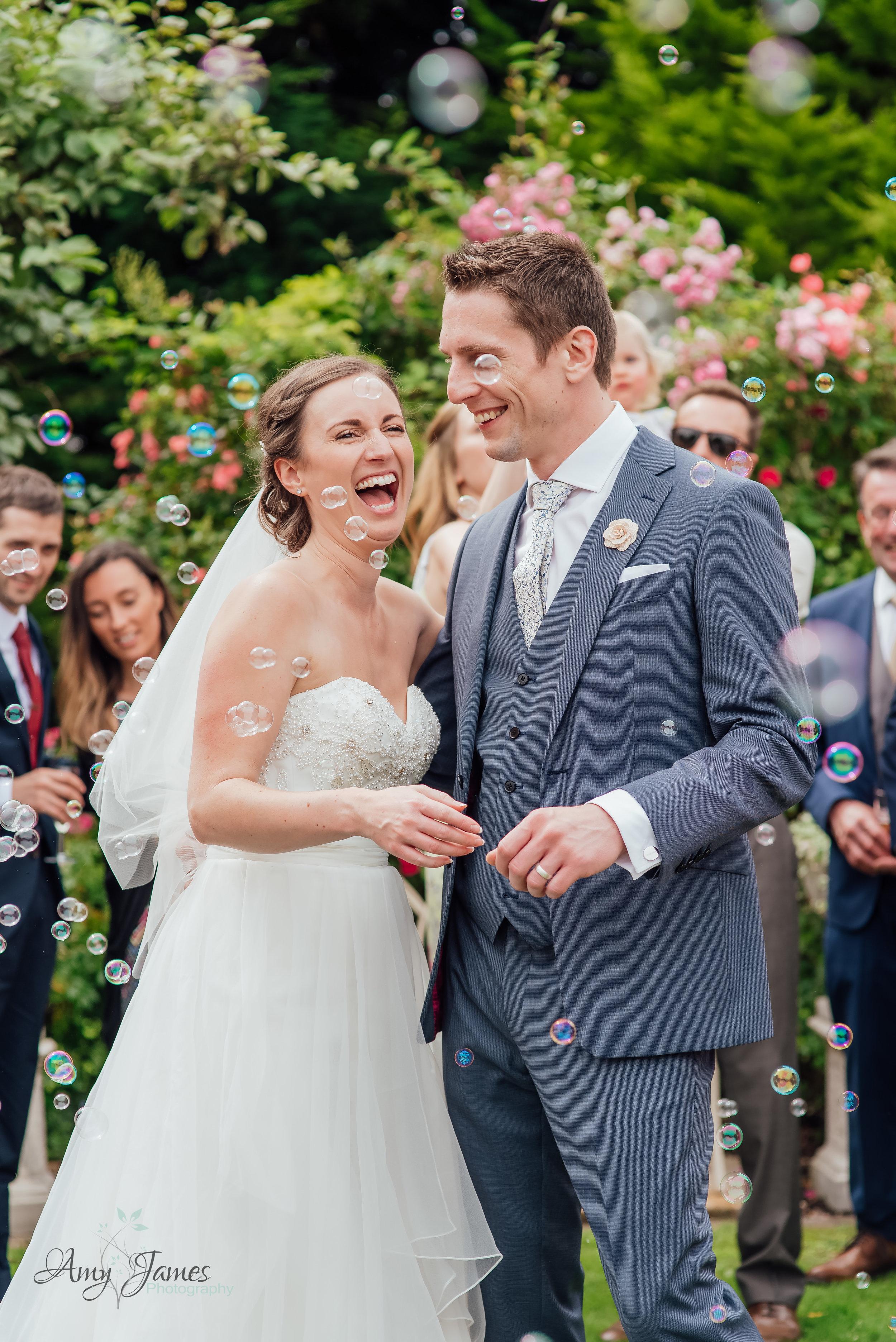 Bubble confetti at outside wedding venue Hampshire - Amy James Photography Hampshire Wedding Photographer