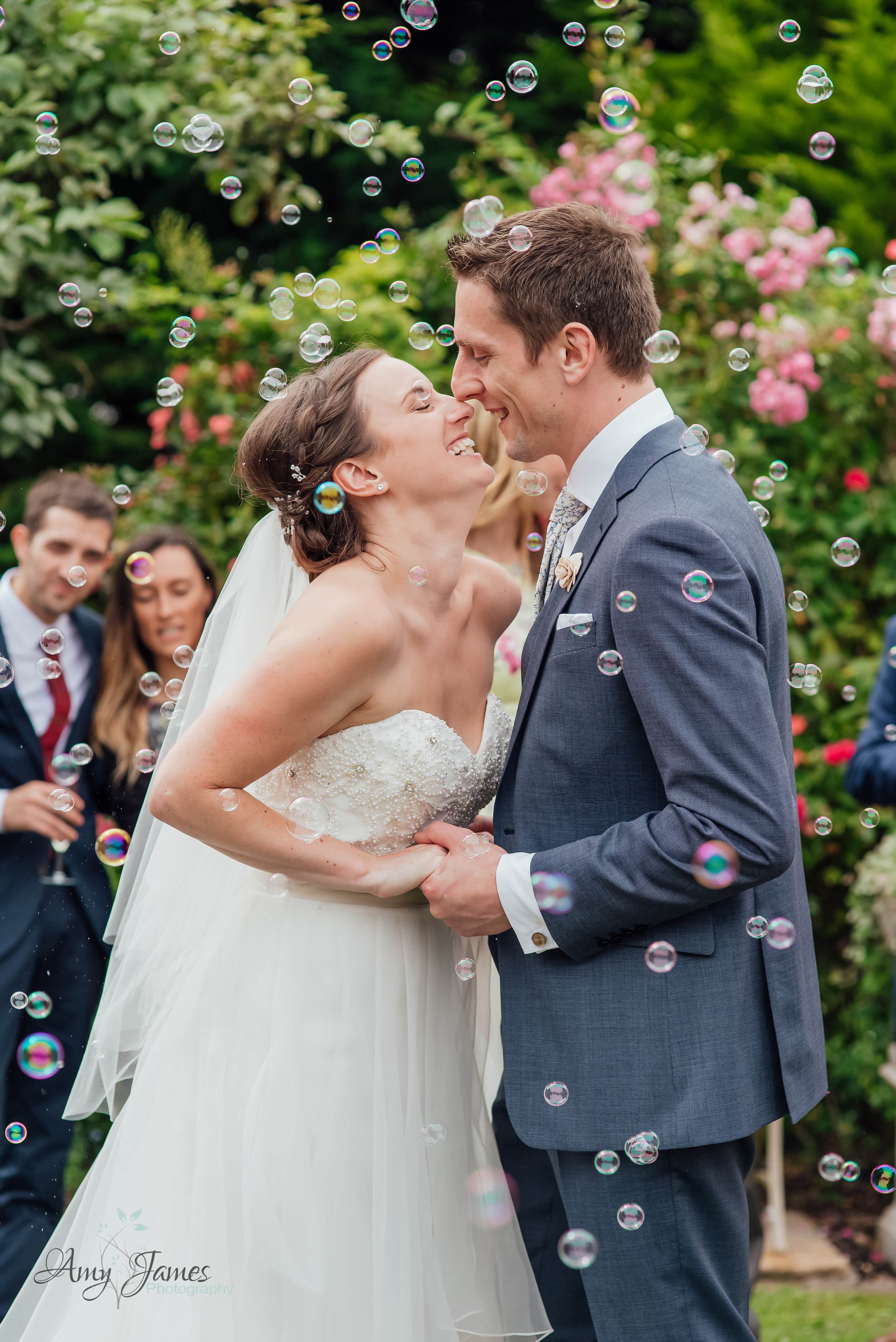 Bubble confetti at outside wedding venue Hampshire by Amy James Photography Hampshire Wedding Photographer