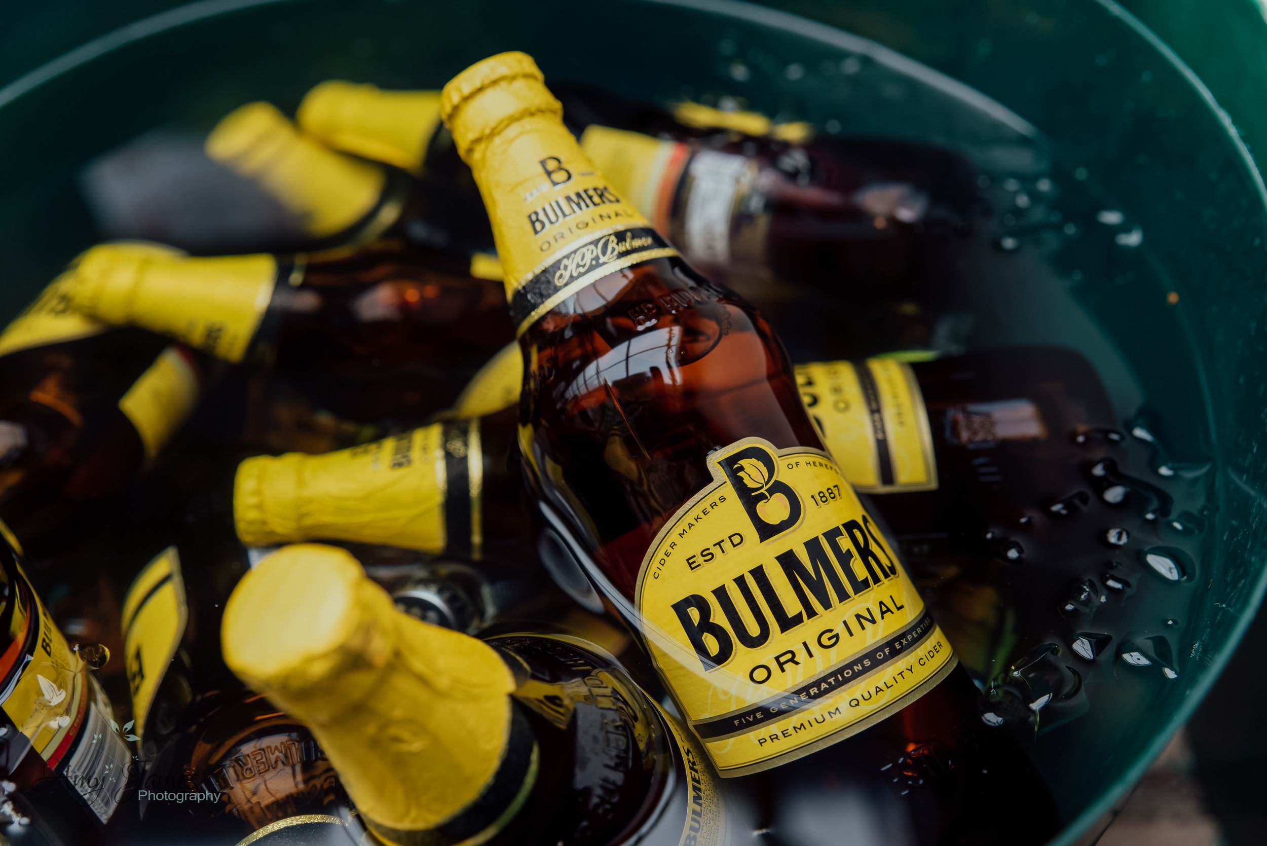 Bulmers Cider at outside wedding venue Hampshire Taplins Place by Amy James Photography Hampshire wedding photographer