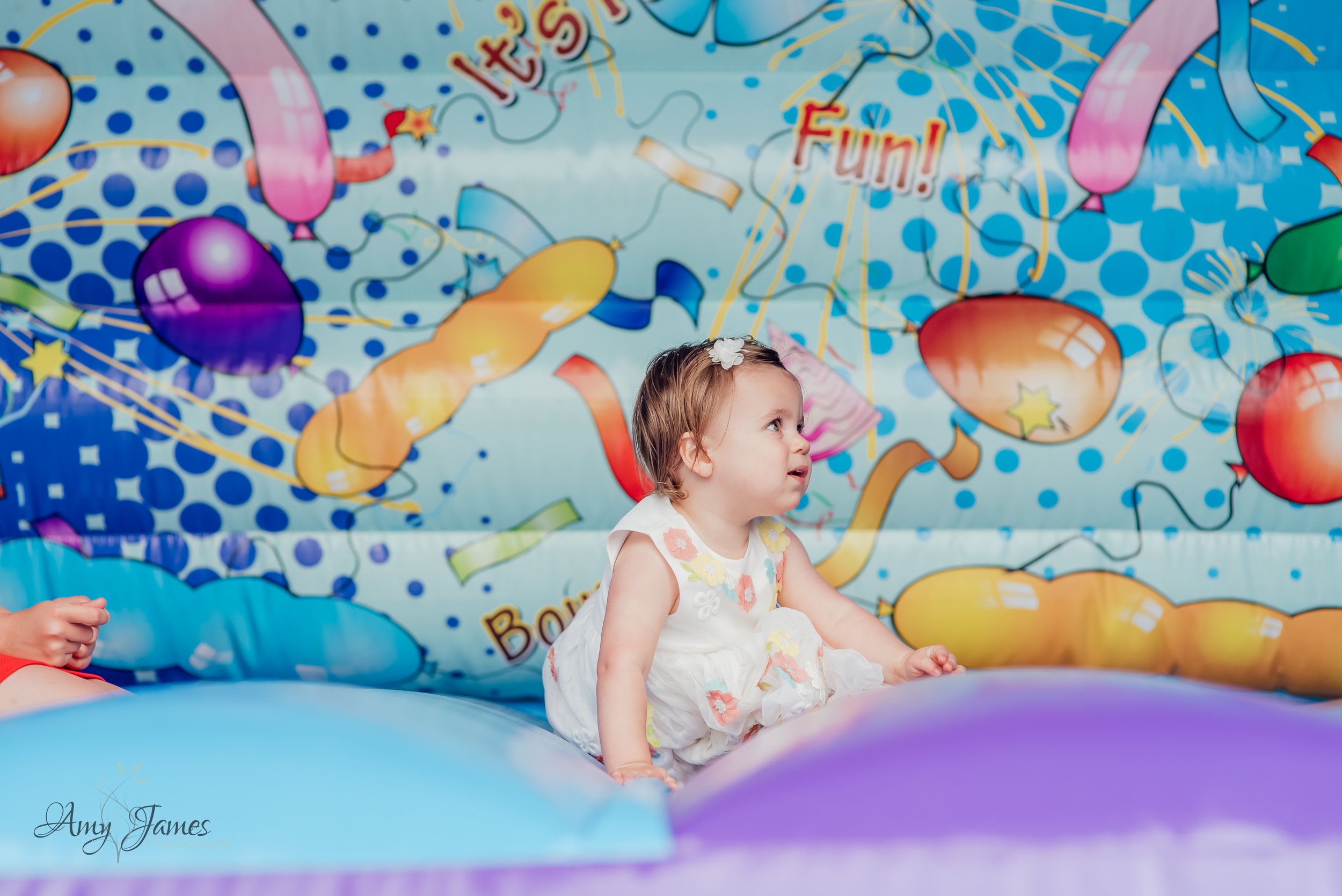 Child on bouncy castle at outside wedding venue Hampshire by Amy James Photography Wedding Photographer for Hampshire and Surrey