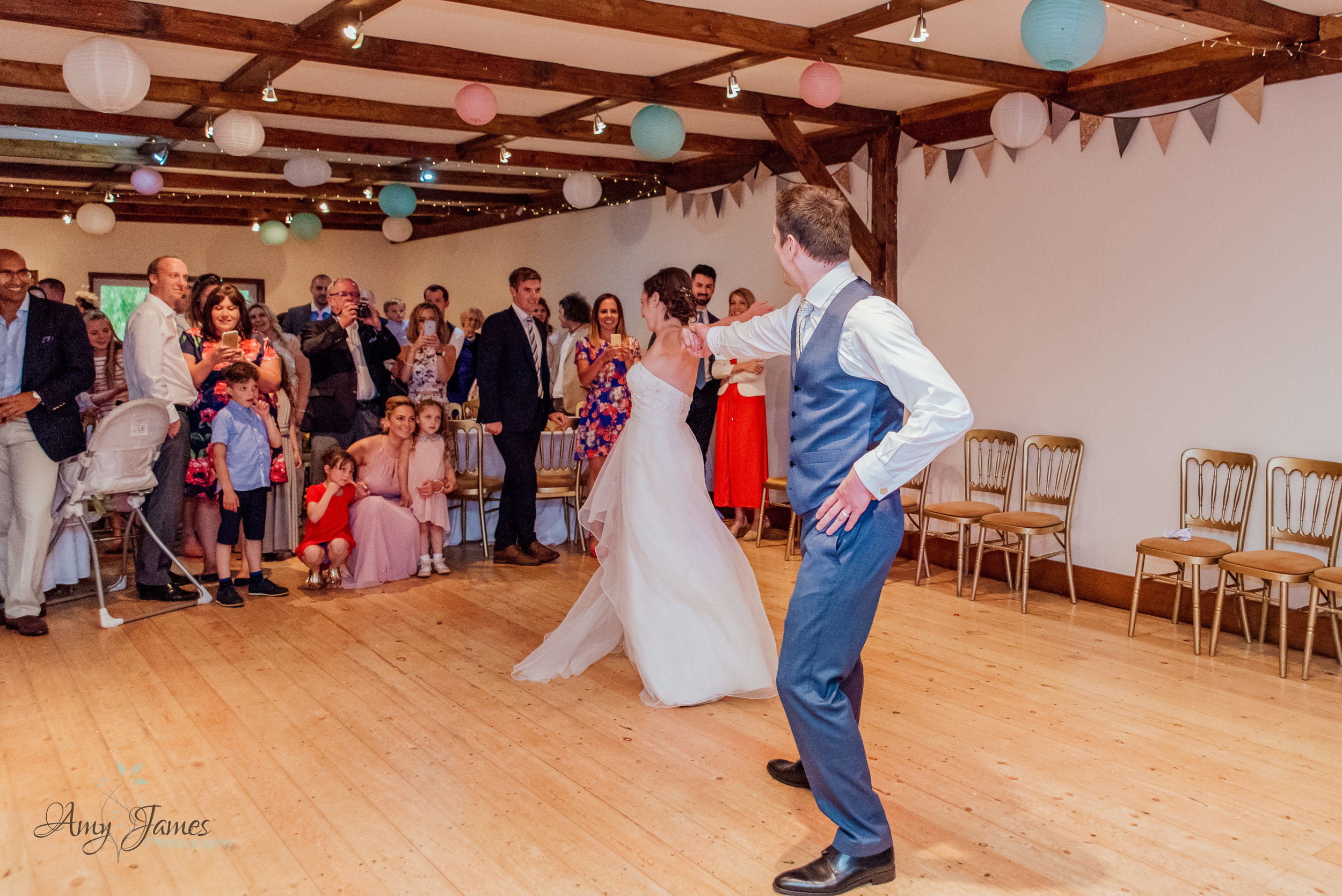 Bride and Groom first dance at Hampshire barn wedding venue by Amy James Photography documentary wedding photographer in Hampshire and Surrey