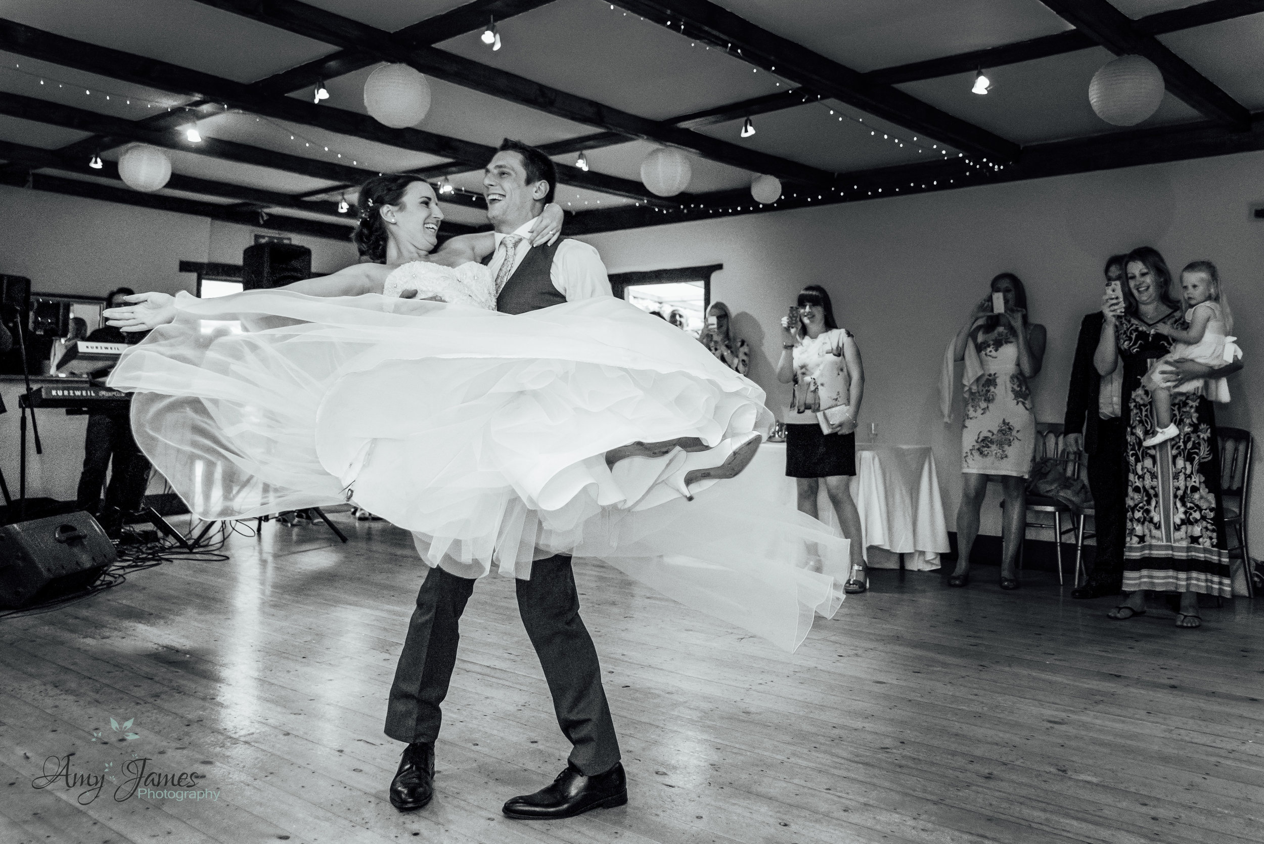 Bride and Groom First Dance at Hampshire barn wedding venue by Amy James Photography documentary wedding photographer for Hampshire and Surrey