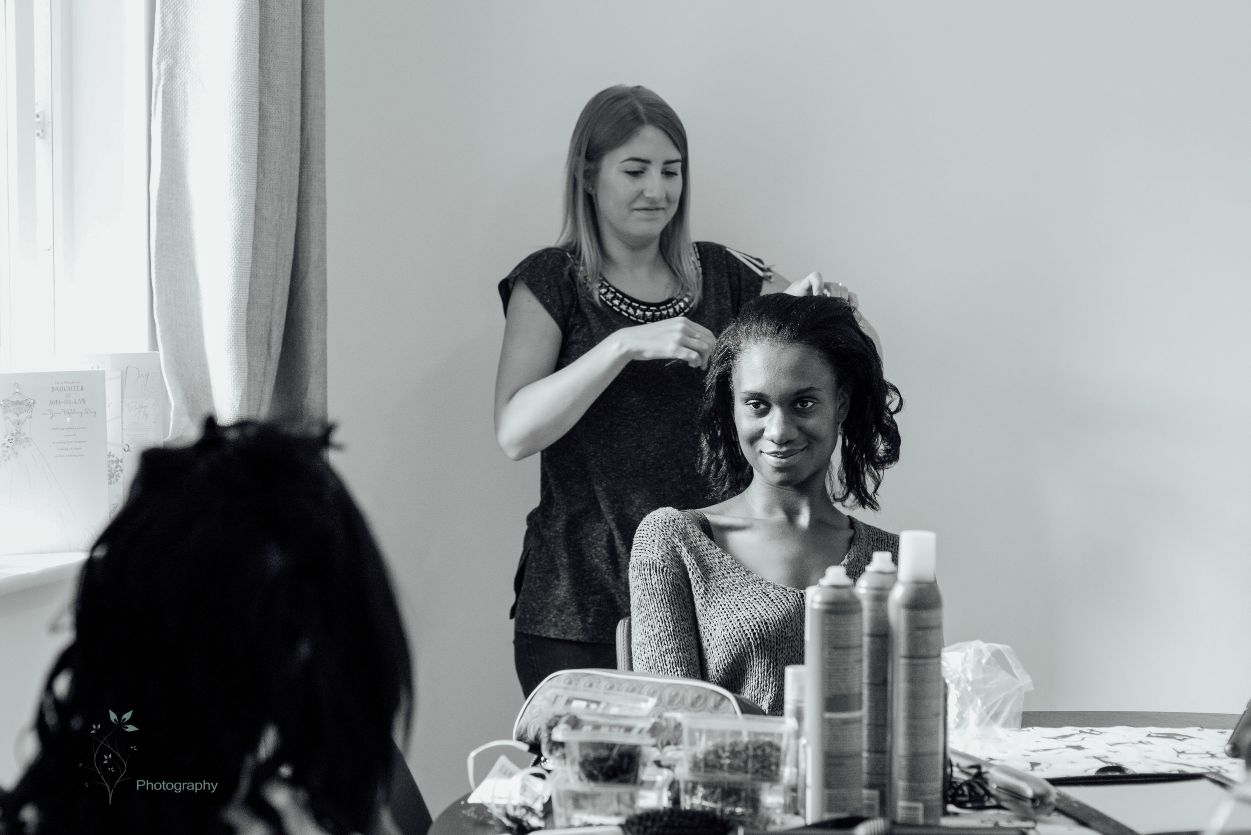 Black and white bridal preparation photo by Amy James Photography - Four Seasons Hotel Hampshire wedding venue - Wedding photographer Hampshire and Surrey