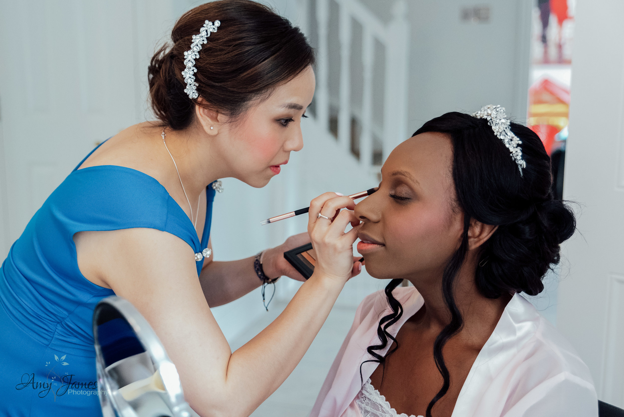 bridal prep by Amy James Photography for Four Seasons Hotel Hampshire Wedding venue - Documentary wedding photographer for Hampshire and Surrey