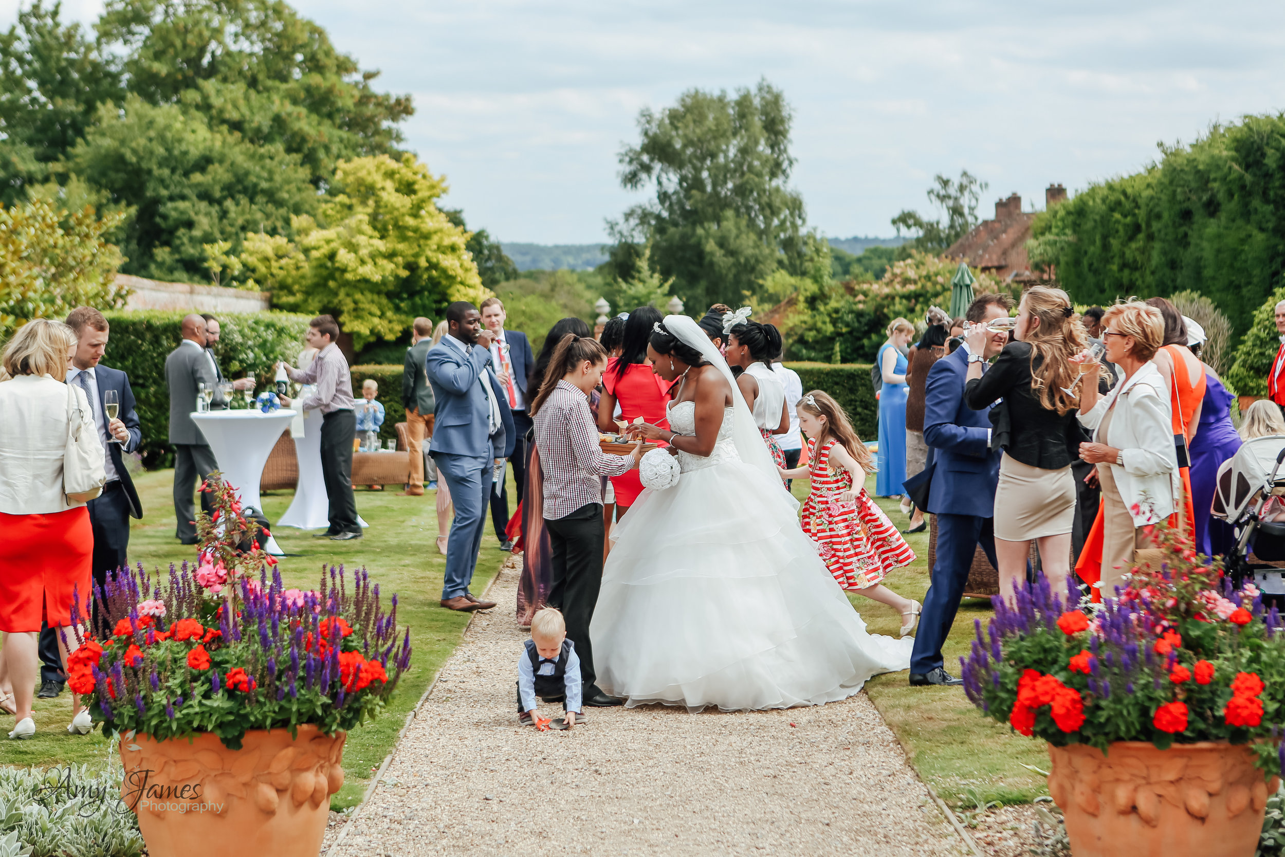 Walled garden wedding reception at Four Seasons Hotel Hampshire by Amy James photography documentary wedding photographer Hampshire and Surrey