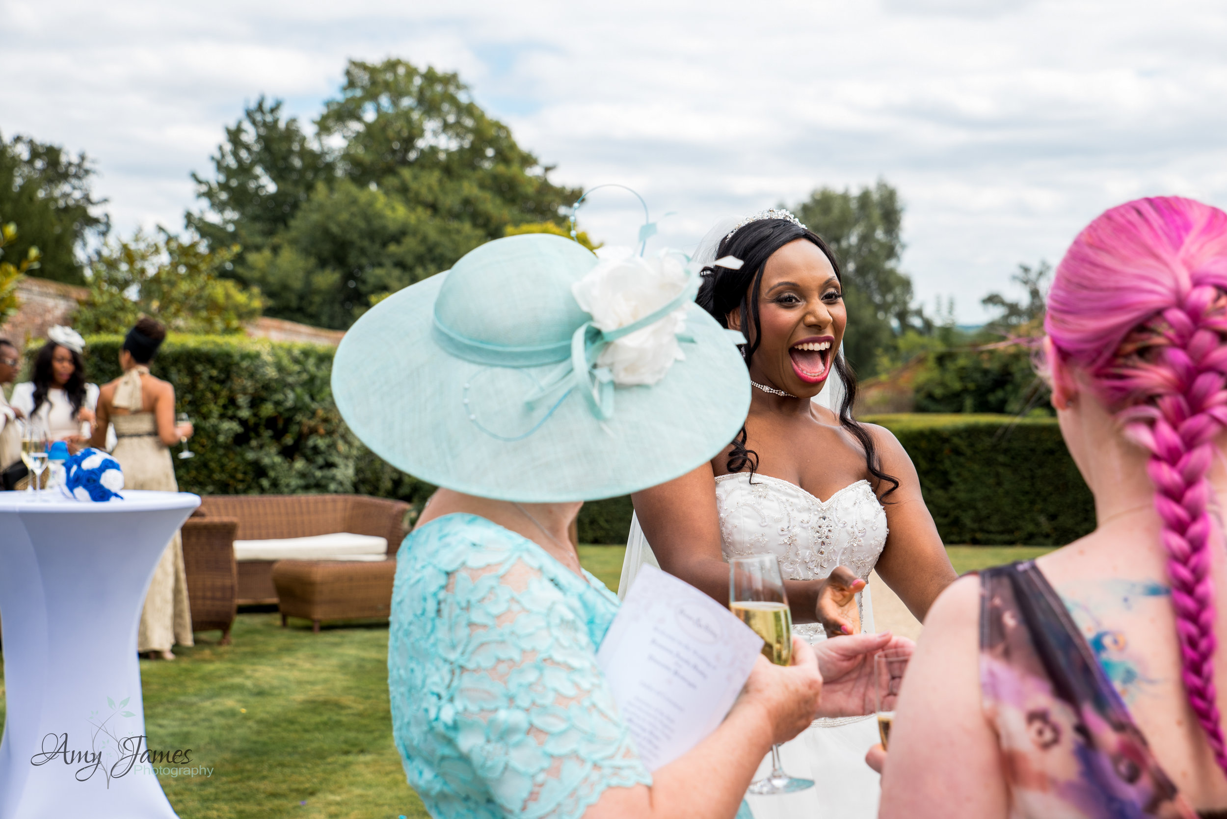 drinks reception in walled garden at four seasons hotel Hampshire by Amy James photography documentary wedding photographer for Hampshire and Surrey