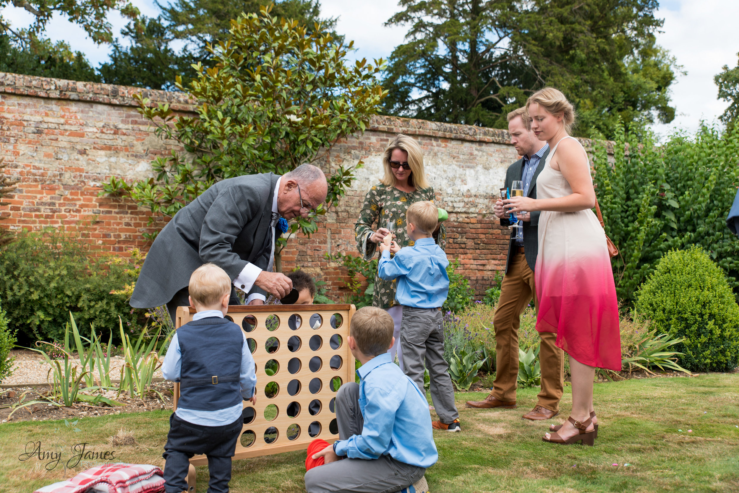Garden games for outdoor wedding venue the Four Season hotel in Hampshire by Amy James Photography documentary wedding photographer for Hampshire and Surrey