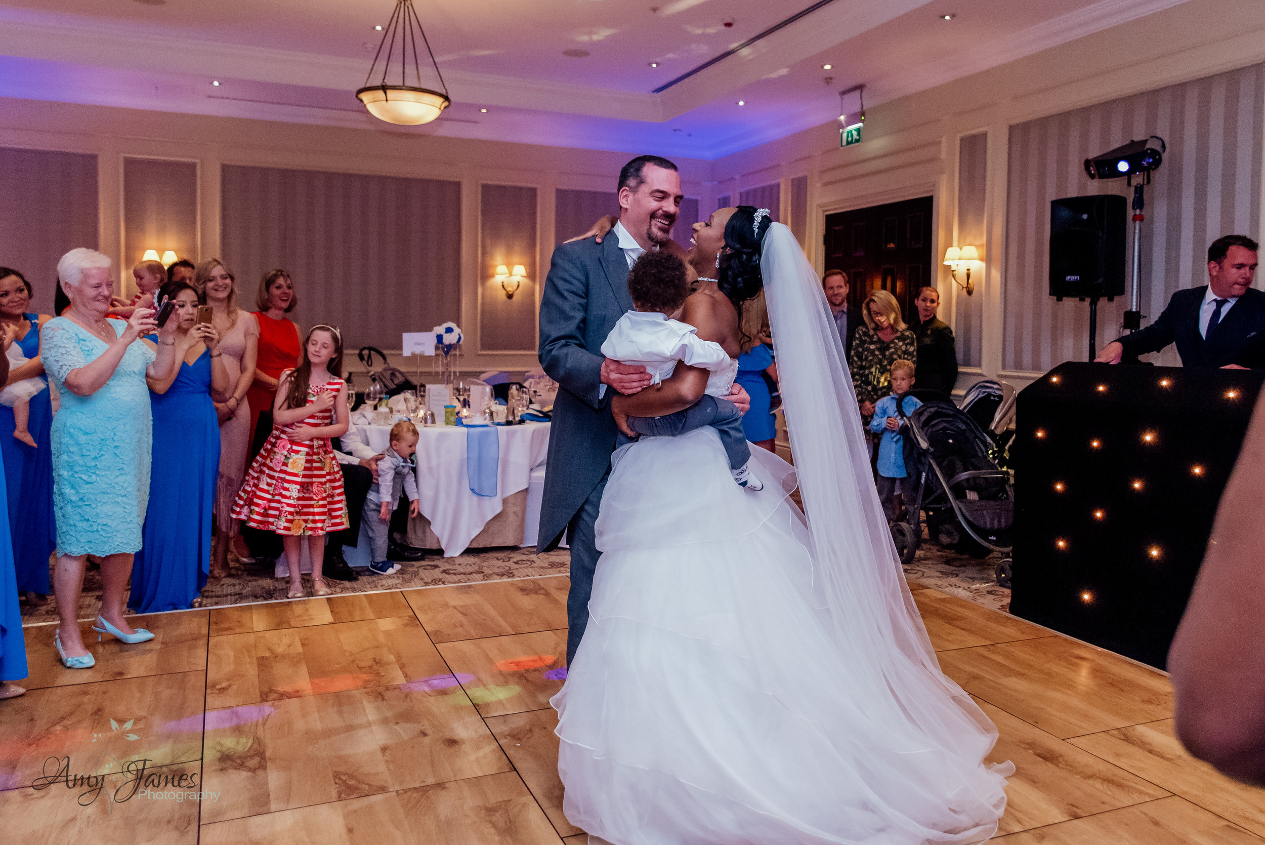 The first dance at Four Seasons Hotel Hampshire by Amy James photography documentary wedding photographer for Hampshire and Surrey