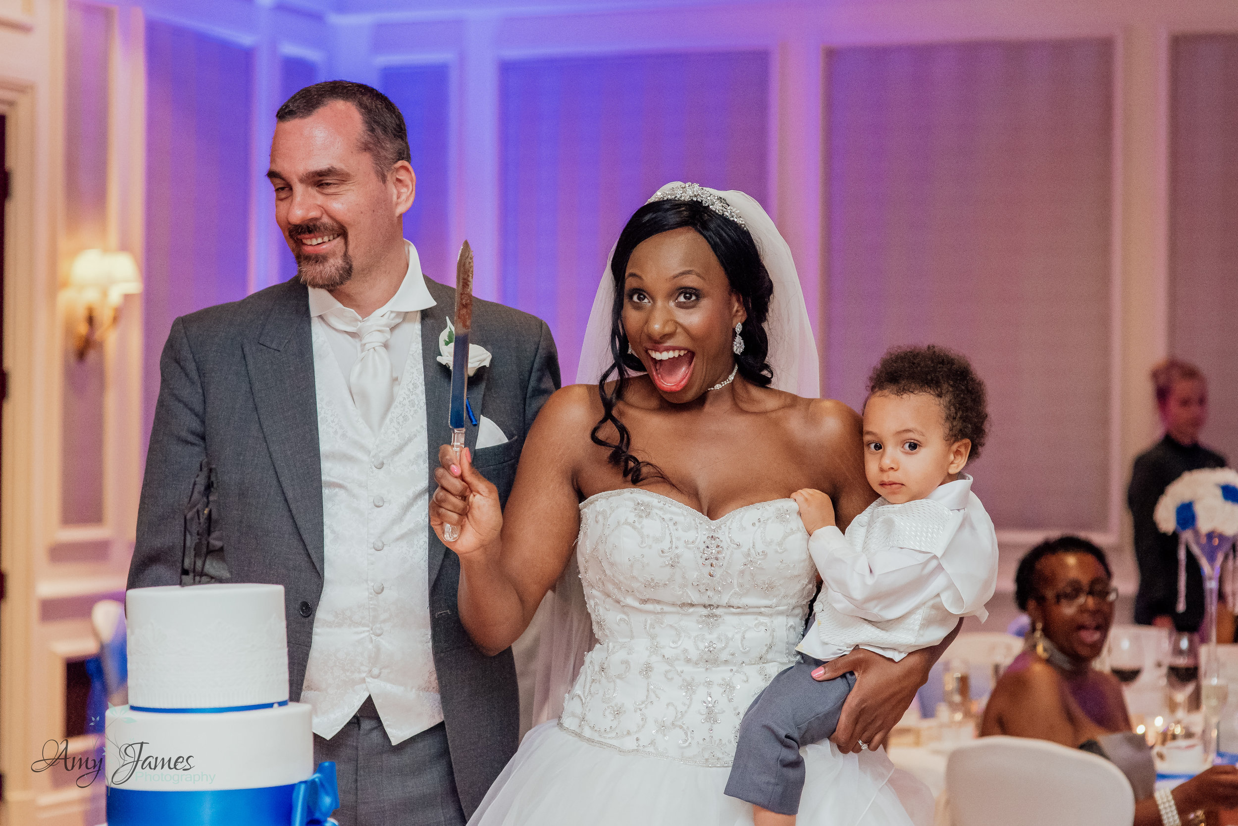 Cutting the wedding cake at Four Seasons Hotel Hampshire by Amy James Photography Hampshire wedding photographer