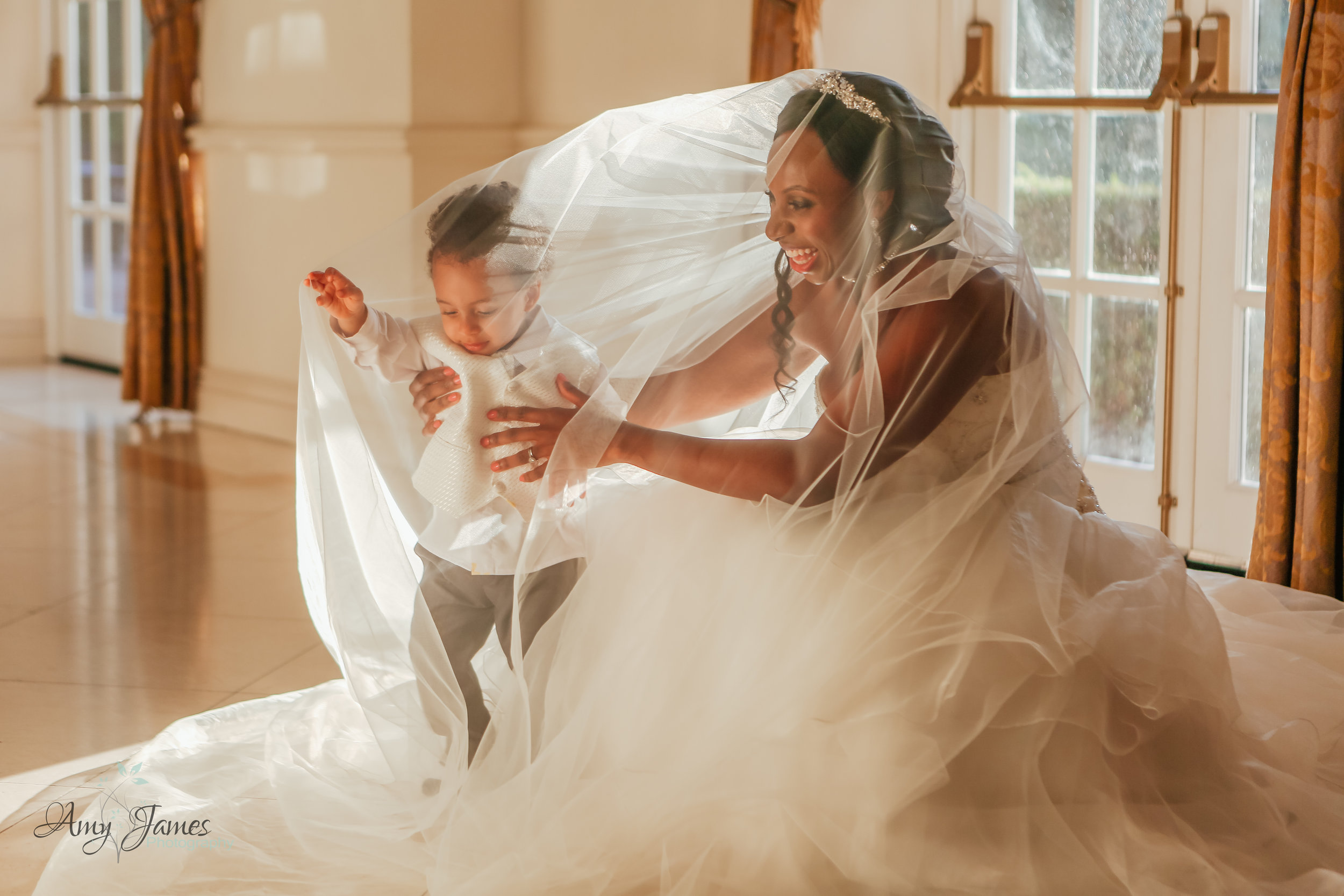 bride with son under veil at Four Seasons Hotel Hampshire - Amy James Photography - Wedding photographer Hampshire Surrey and Berkshire