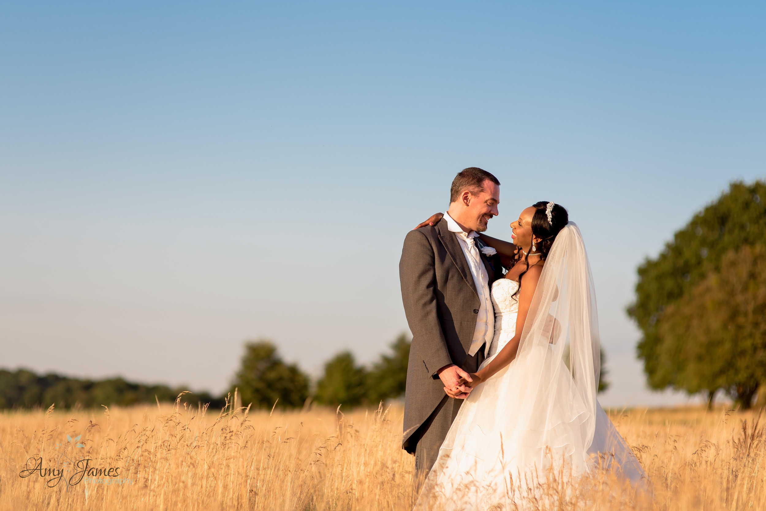 Sunset photo of Bride and Groom at Four Seasons Hotel Hampshire Wedding Venue - Amy James Photography - Hampshire wedding photographer